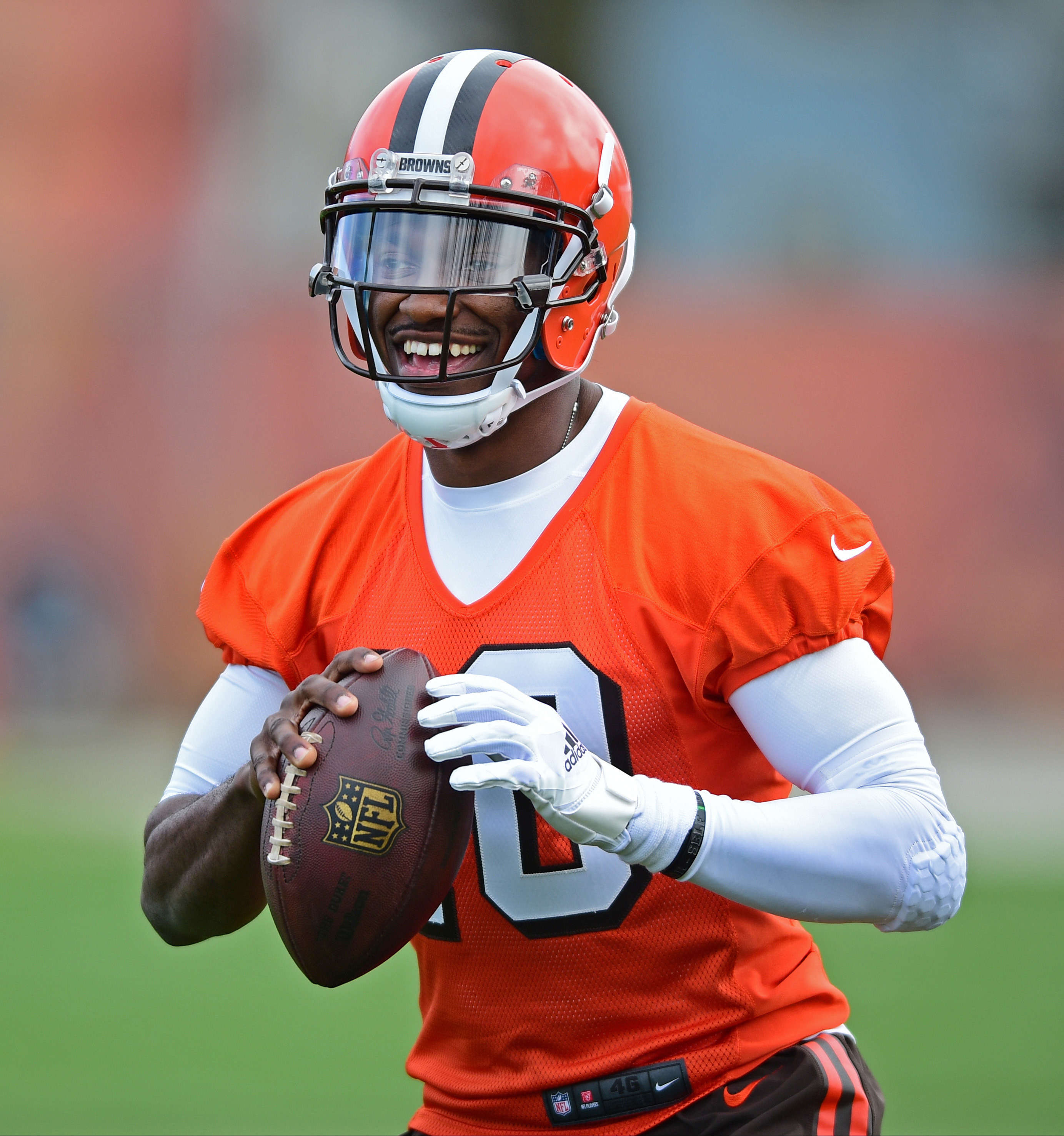 FILE - In this April 19, 2016, file photo, Cleveland Browns' Robert Griffin III smiles during practice at the NFL football team's minicamp in Berea, Ohio. Griffin III is excited to have a chance to resurrect his career in Cleveland after it fell apart wit