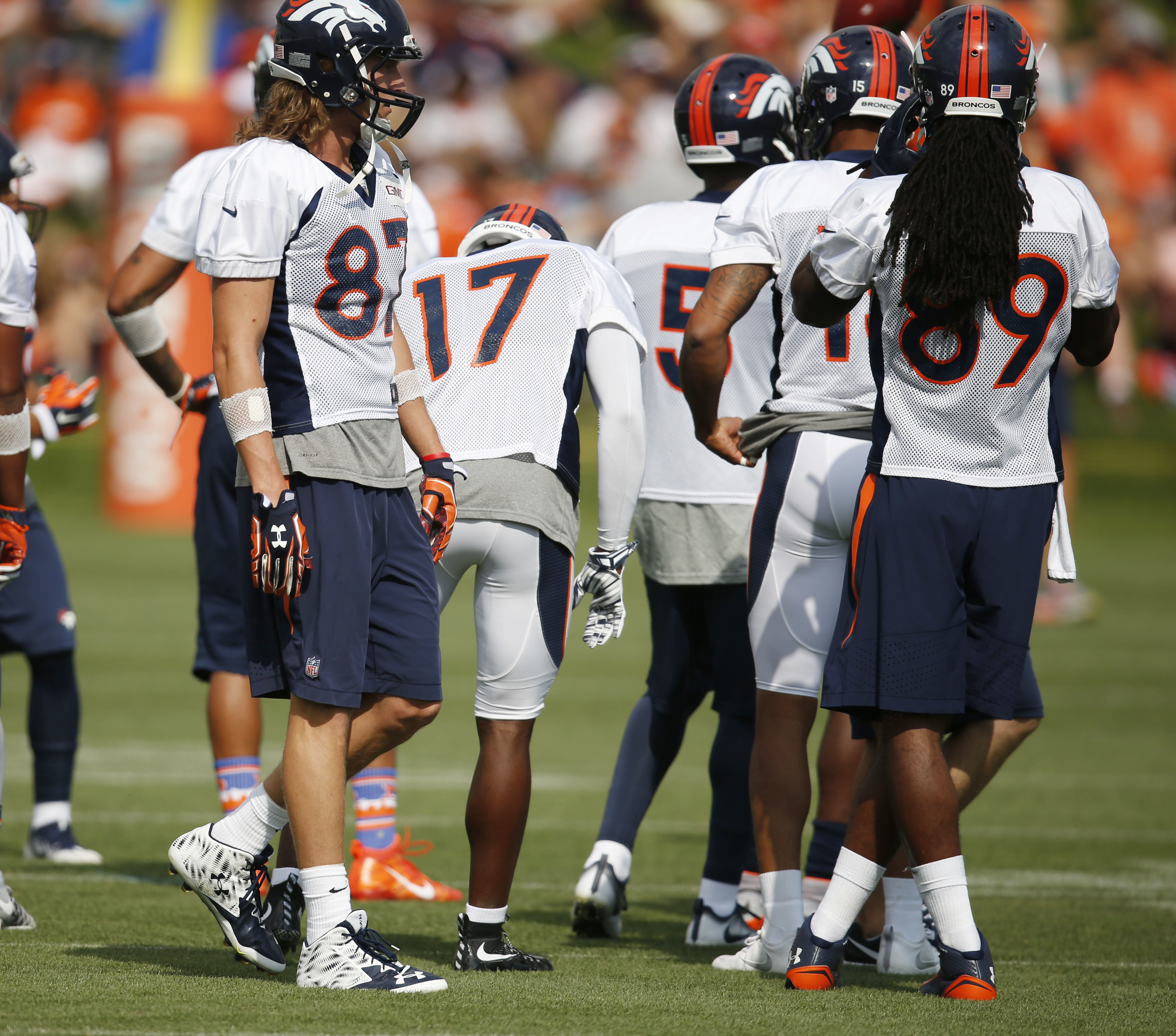 Denver Broncos wide receiver Jordan Taylor, left, joins teammates to take part in drills during the team's NFL football training camp Friday, July 29, 2016 in Englewood, Colo. (AP Photo/David Zalubowski)