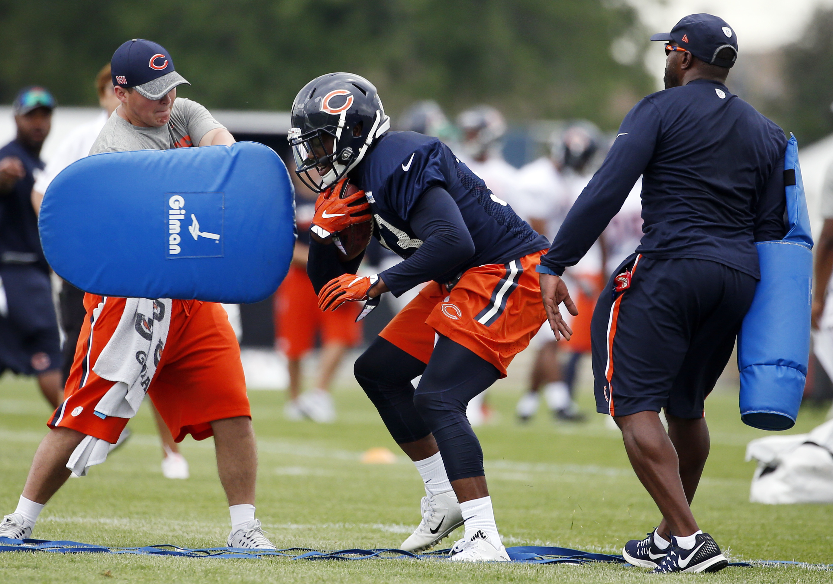 Chicago Bears running back Jeremy Langford works on the field during practice at the NFL football teams training camp at Olivet Nazarene University, in Bourbonnais, Ill., Friday, July 29, 2016. (AP Photo/Nam Y. Huh)