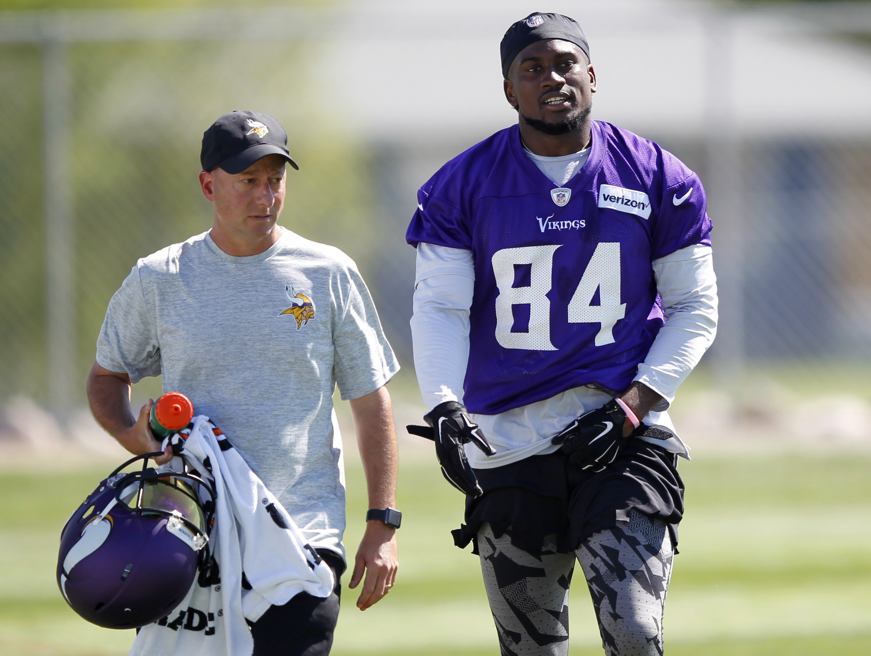 Minnesota Vikings wide receiver Cordarrelle Patterson (84) is escorted off the field with a trainer after Patterson was shaken up during the first day of the NFL football team's training camp at Mankato State University in Mankato, Minn., on Friday, July,