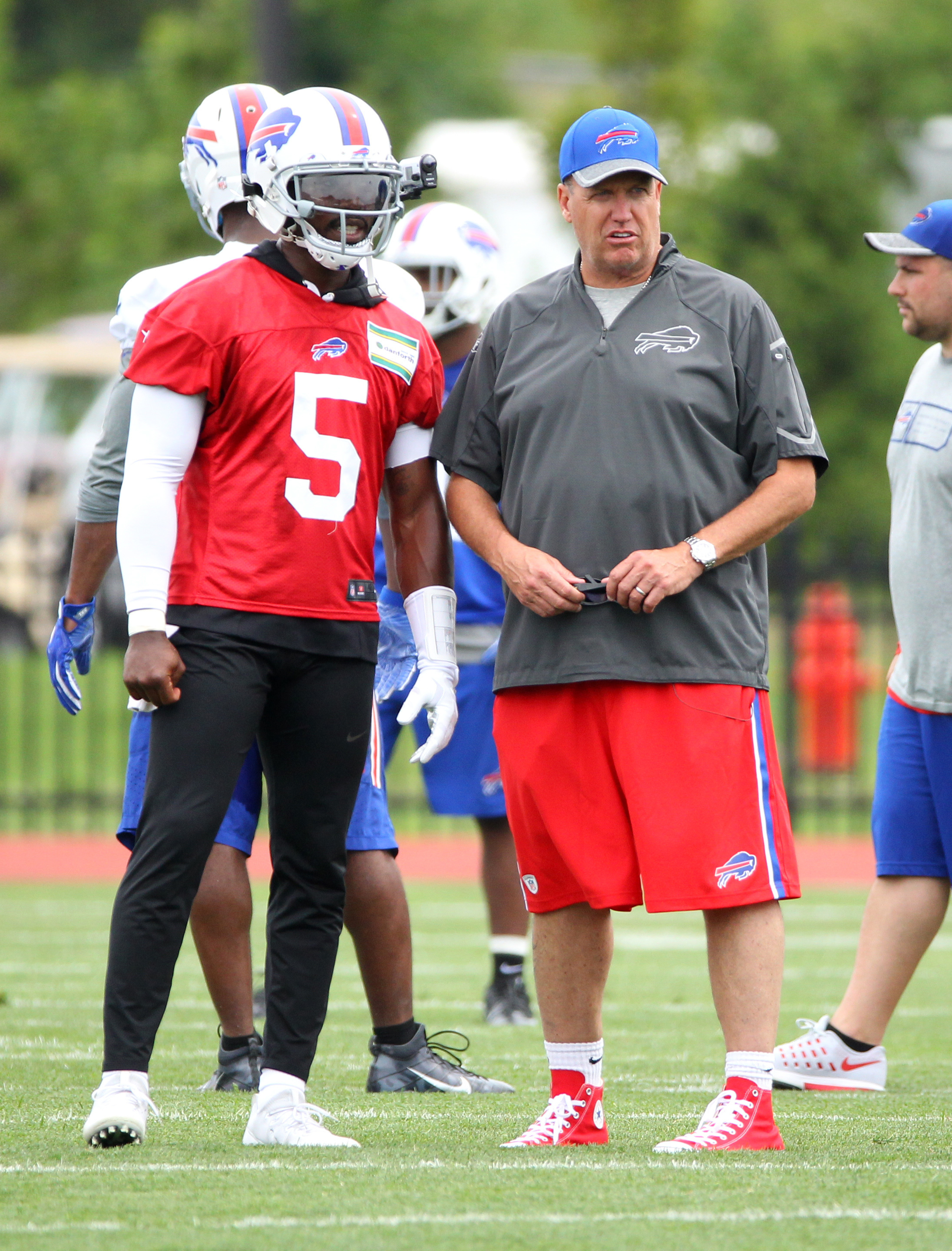 Buffalo Bills head coach Rex Ryan talks to Tyrod Taylor (5) during NFL football training camp in Pittsford, N.Y., Saturday, July 30, 2016. (AP Photo/Bill Wippert)