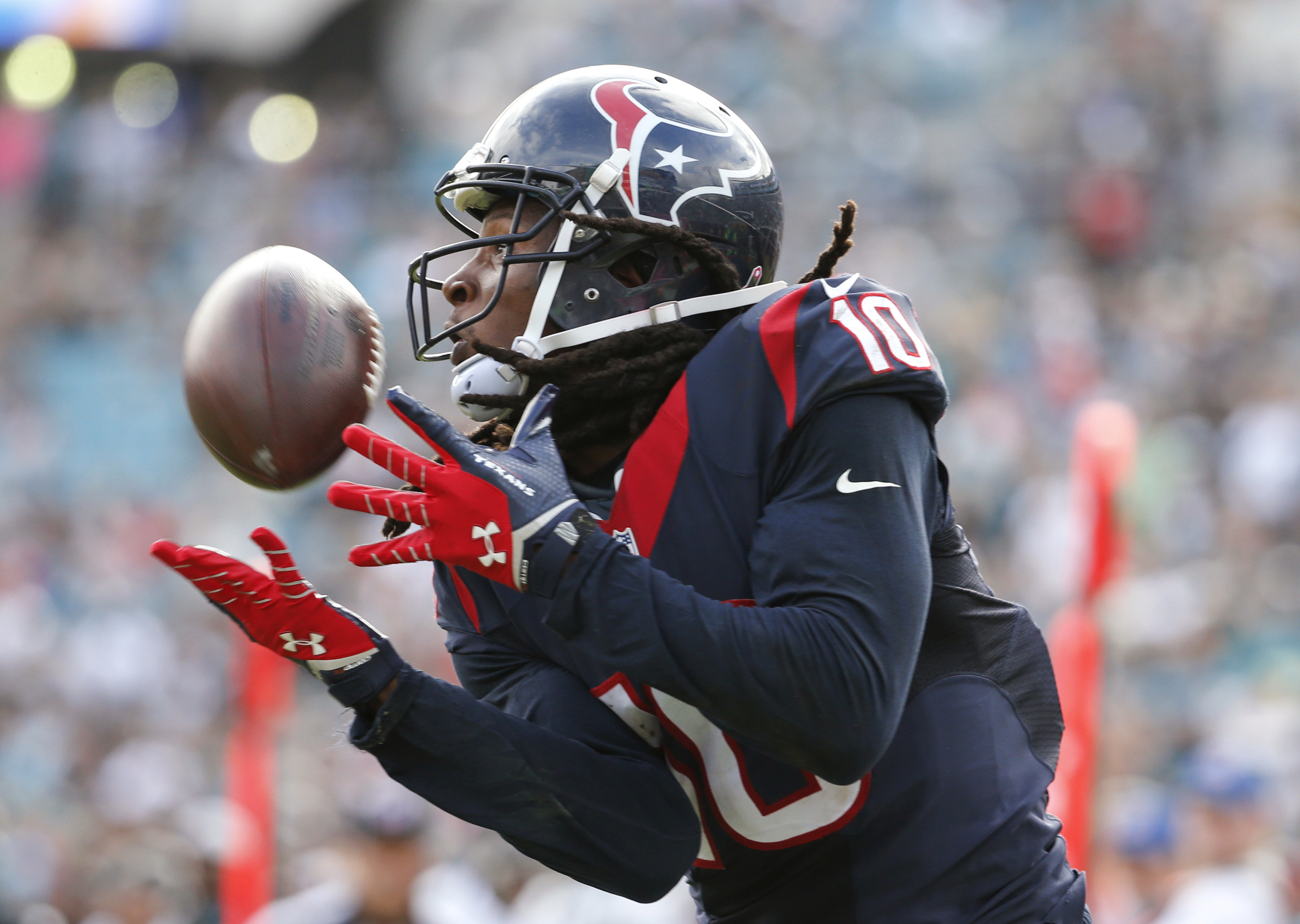 FILE - In this Oct. 18, 2015, file photo, Houston Texans wide receiver DeAndre Hopkins makes a catch for a touchdown against the Jacksonville Jaguars during an NFL football game in Jacksonville, Fla. Hopkins did not report to training camp Saturday, July