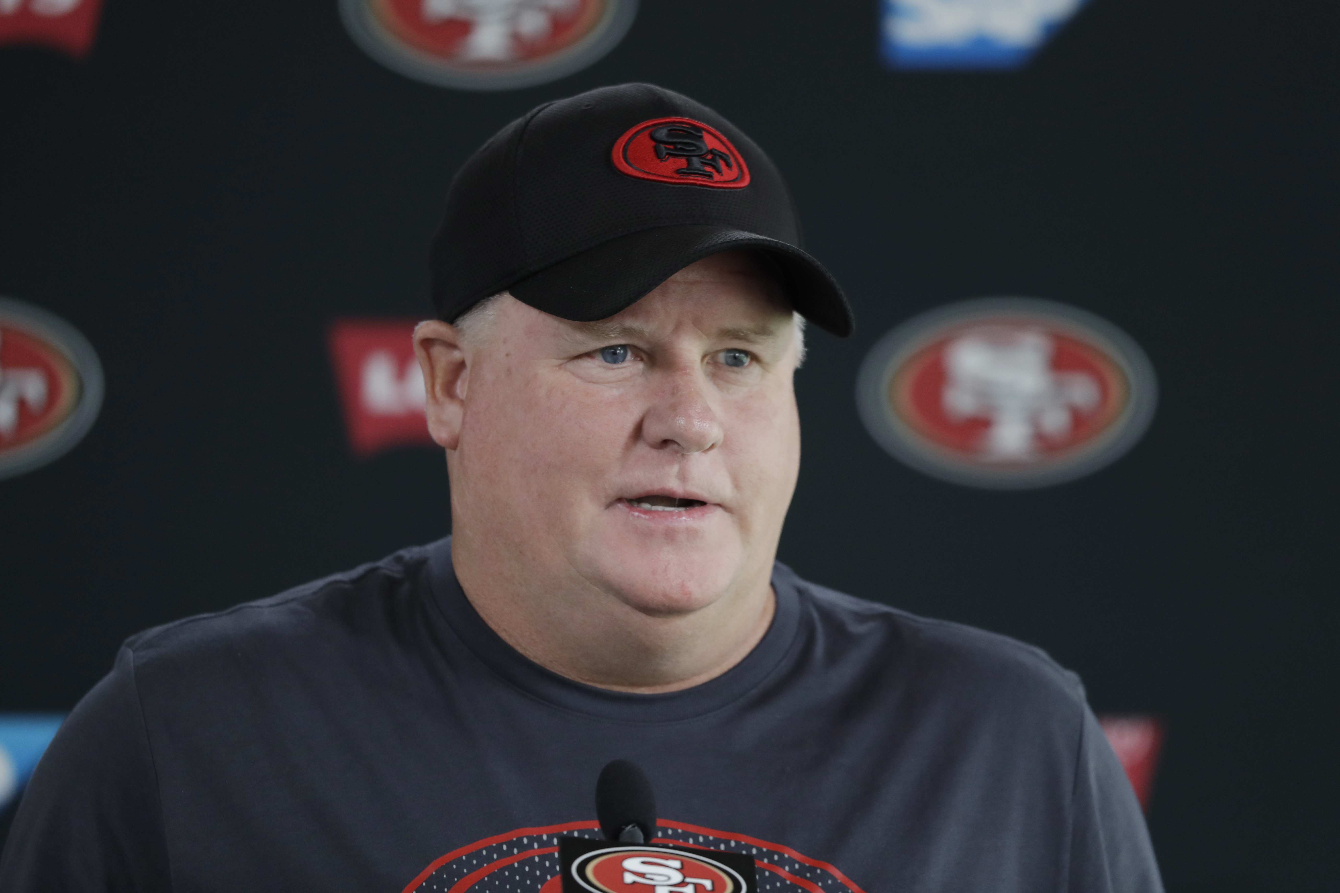 San Francisco 49ers head coach Chip Kelly fields questions during NFL football training camp Sunday, July 31, 2016, in Santa Clara, Calif. (AP Photo/Marcio Jose Sanchez)