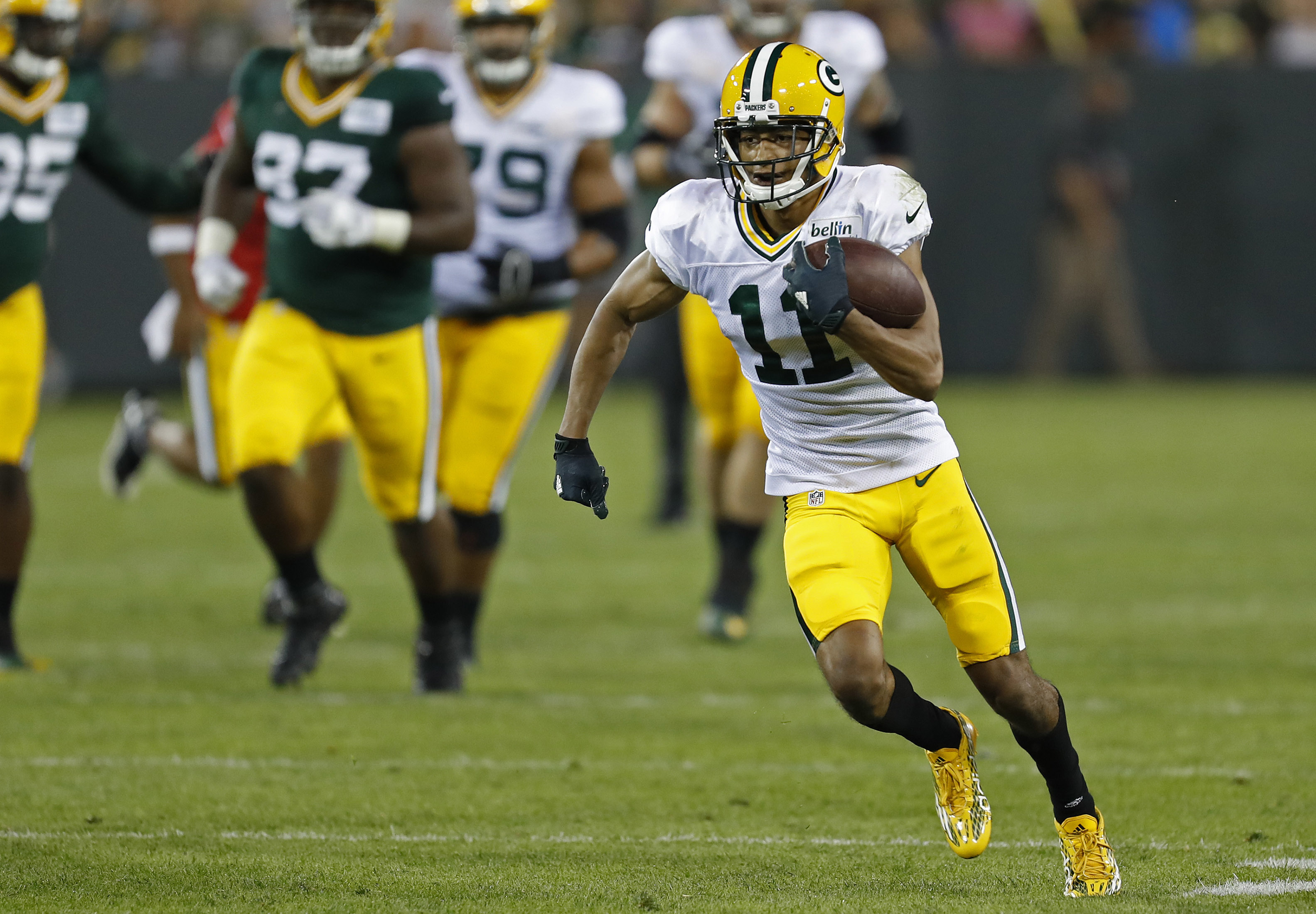 Green Bay Packers wide receiver Trevor Davis runs after making a catch during NFL football training camp, Sunday, July 31, 2016, in Green Bay, Wis. (AP Photo/Matt Ludtke)