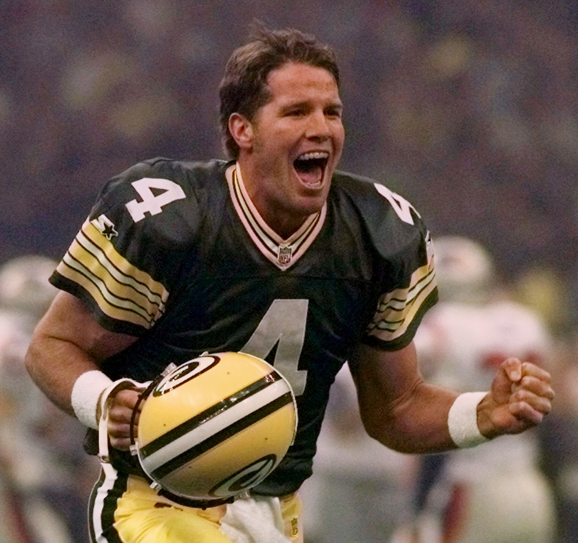 FILE - In this Jan. 26, 1997, file photo, Green Bay Packers quarterback Brett Favre celebrates after throwing a touchdown pass to Andre Rison during the Super Bowl in New Orleans. Favre was equal parts desperado and virtuoso during his 20-year NFL career