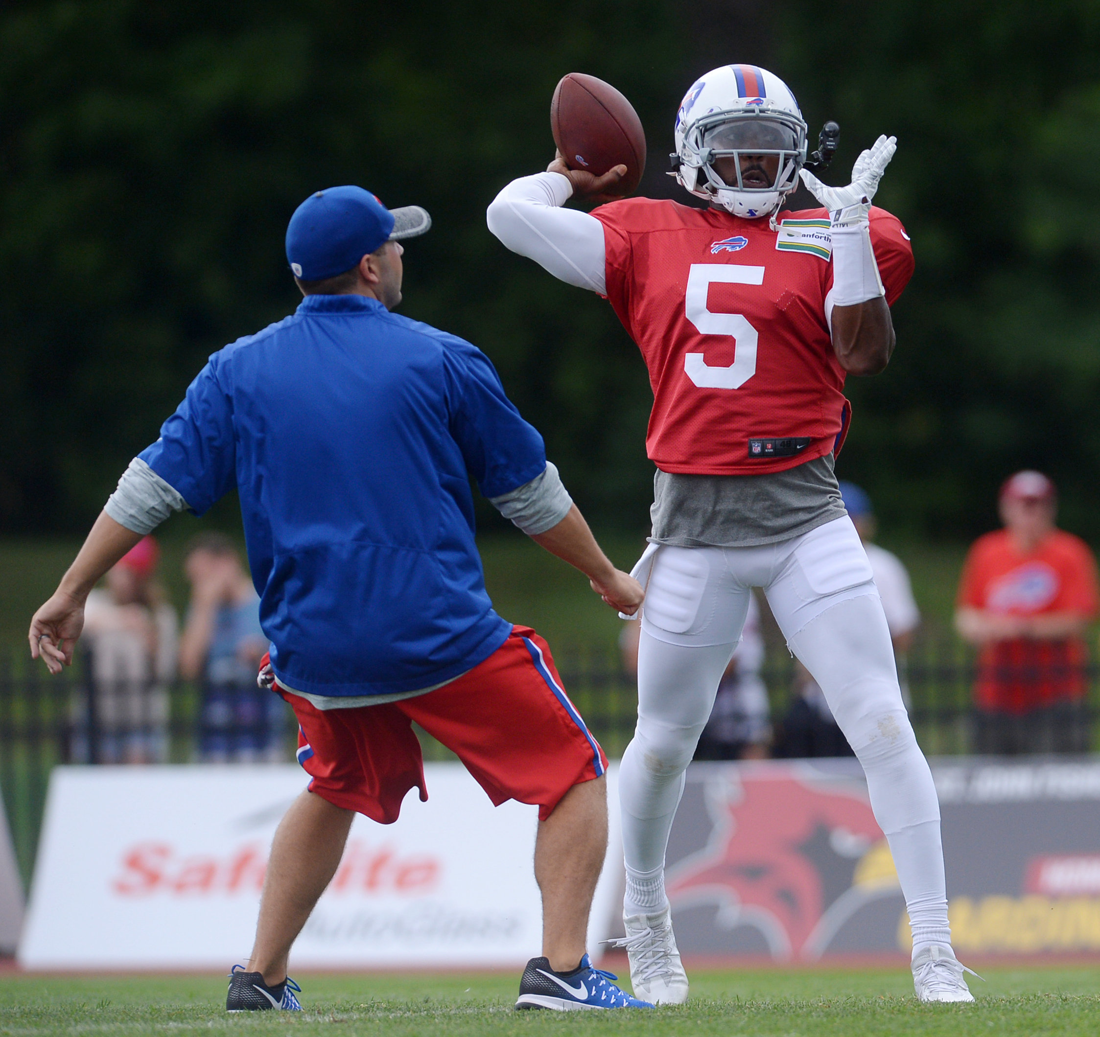 Buffalo Bills quarterback Tyrod Taylor throws a pass during practice at the NFL football team training camp in Pittsford, N.Y., Monday, August 1, 2016. (AP Photo/Adrian Kraus)