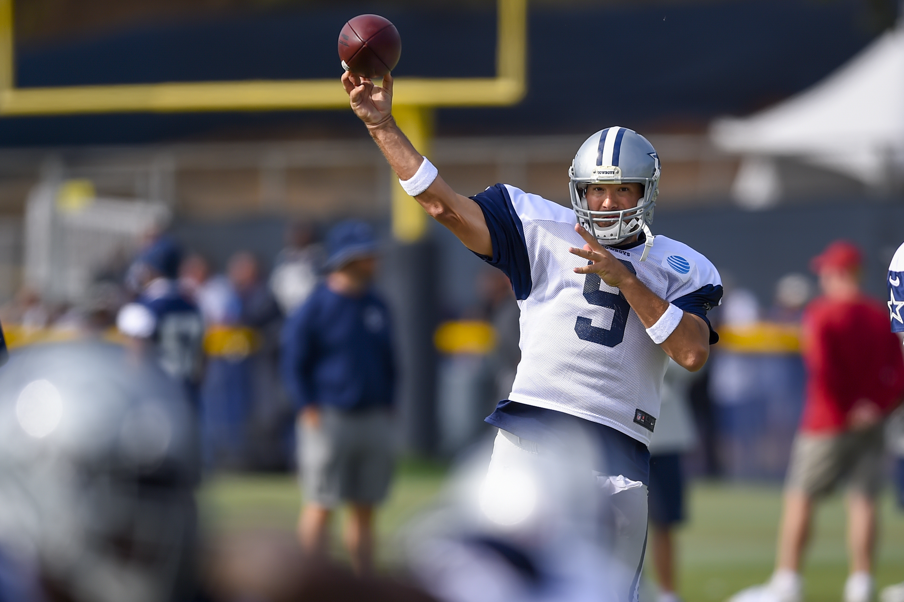 Dallas Cowboys quarterback Tony Romo makes a pass during Dallas Cowboys' NFL football training camp, Monday, Aug. 1, 2016, in Oxnard, Calif. (AP Photo/Gus Ruelas)