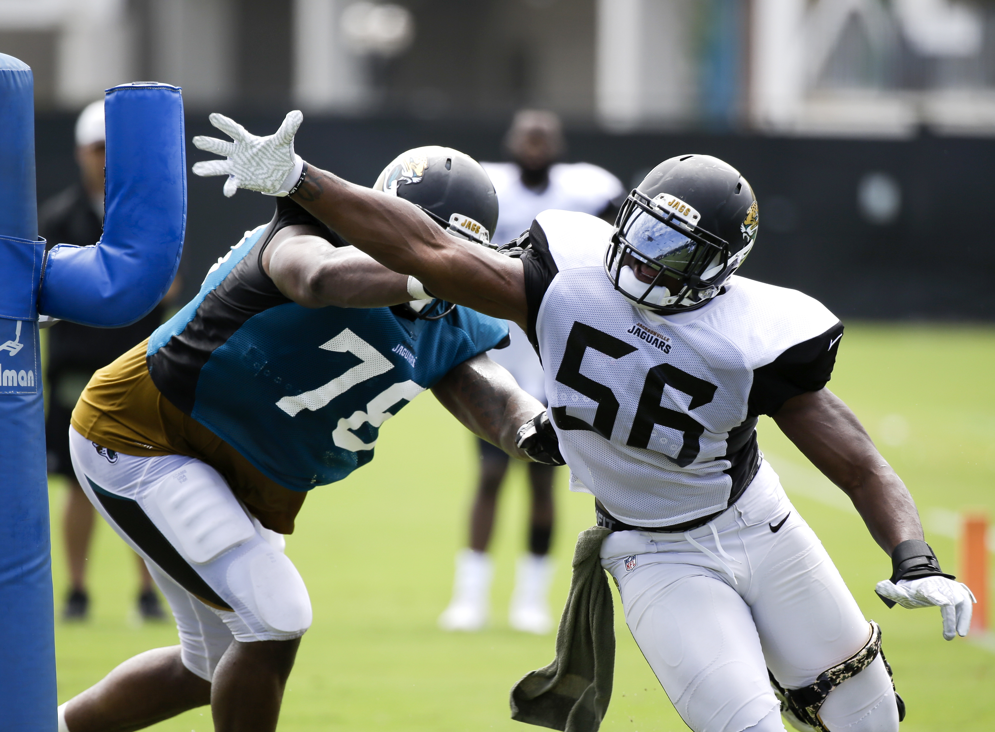Jacksonville Jaguars defensive end Dante Fowler Jr., (56) works to get around offensive tackle Jermey Parnell (78) during a drill at NFL football training camp, Tuesday, Aug. 2, 2016, in Jacksonville, Fla. (AP Photo/John Raoux)
