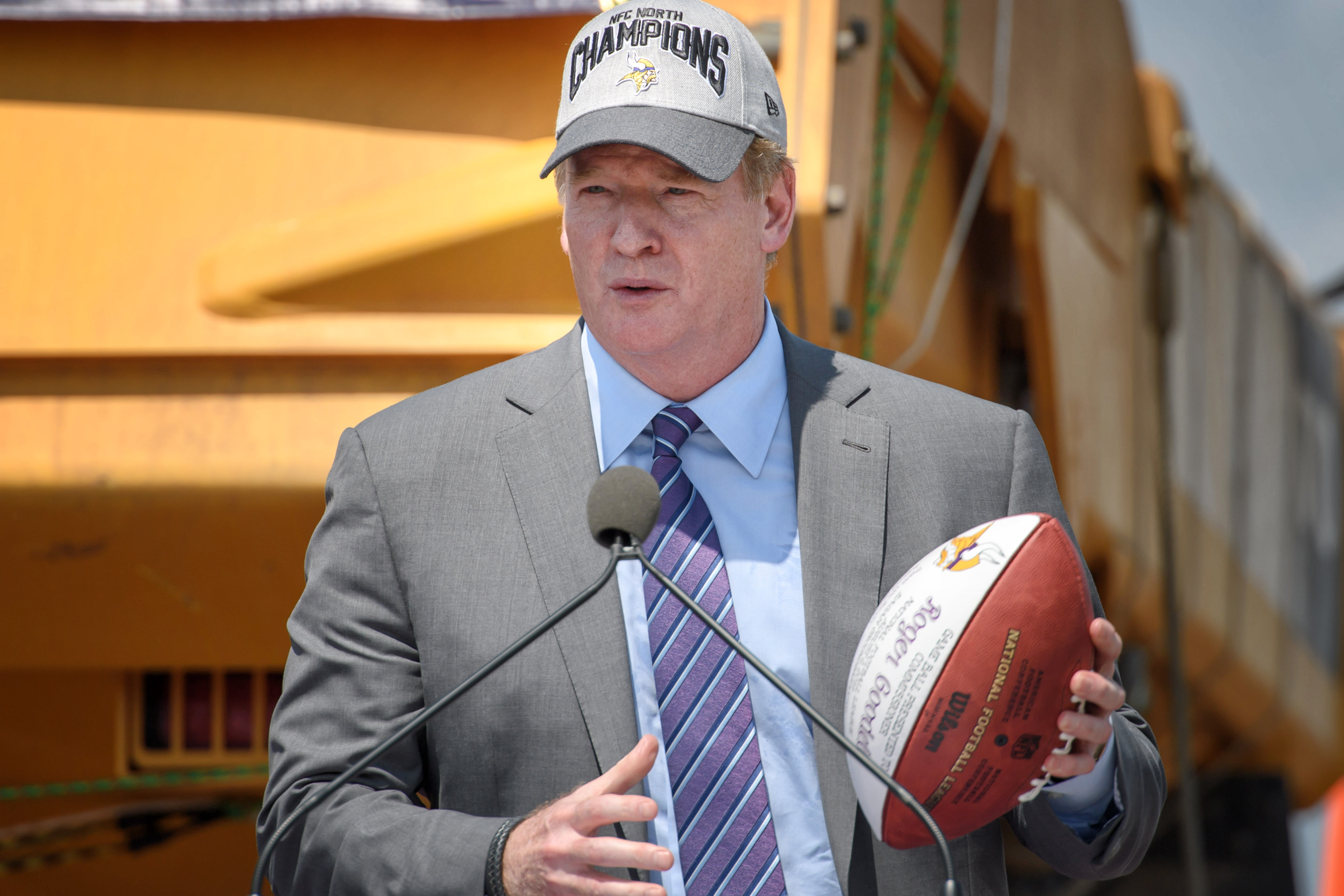 NFL Commissioner Roger Goodell holds a commemorative football at a groundbreaking ceremony for the Minnesota Vikings' new NFL football training facility and team offices they will move into in 2018, in Eagan, Minn., Tuesday, Aug. 2, 2016. (Glen Stubbe/Sta