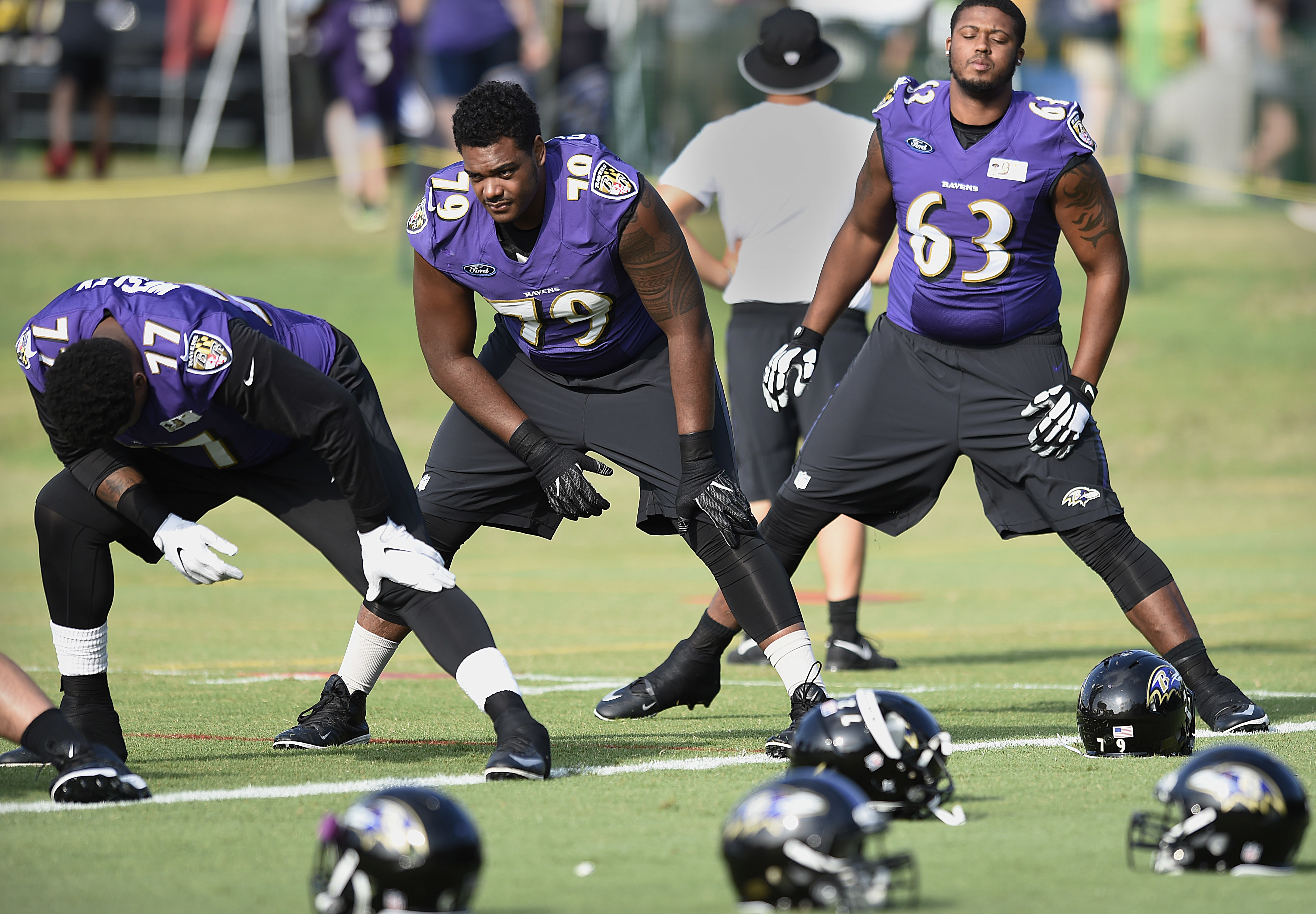 Baltimore Ravens tackle Ronnie Stanley, center, warms up during NFL football training camp in Owings Mills, Md., Wednesday, Aug. 3, 2016. (AP Photo/Gail Burton)