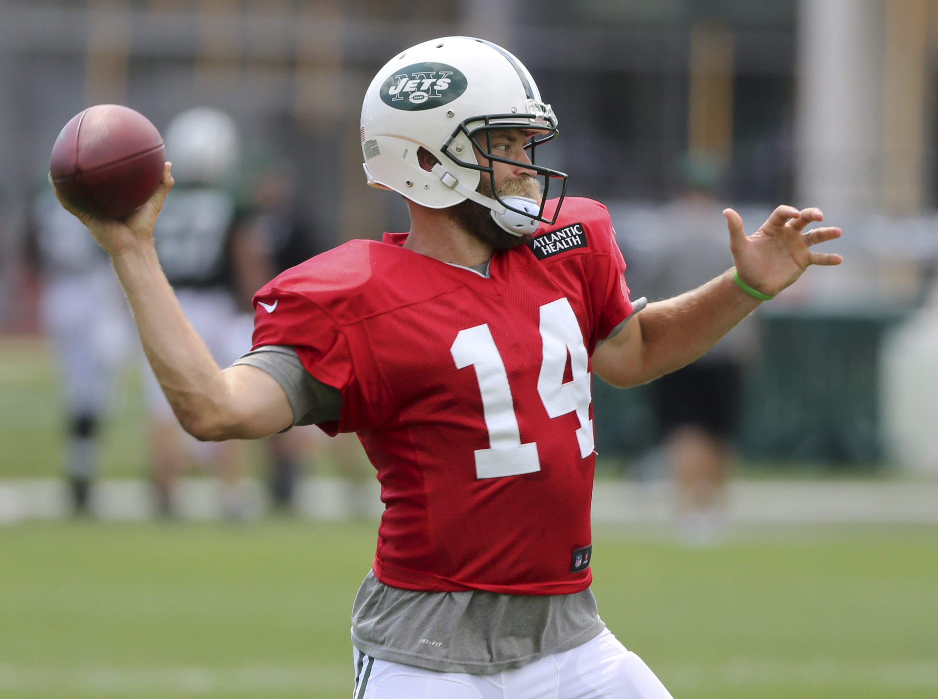 New York Jets quarterback Ryan Fitzpatrick throws during practice at the NFL football team's training camp in Florham Park, N.J., Wednesday, Aug. 3, 2016. (AP Photo/Seth Wenig)