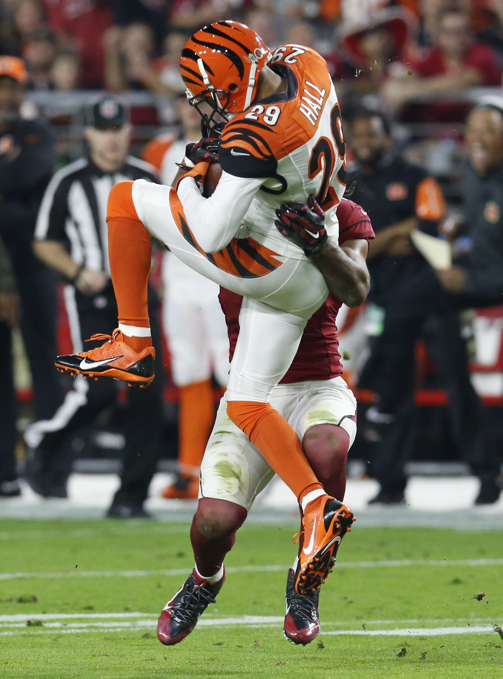 FILE - In this Nov. 22, 2015, file photo, Cincinnati Bengals strong safety Leon Hall (29) intercepts a pass intended for Arizona Cardinals wide receiver Larry Fitzgerald (11) during the first half of an NFL football game, in Glendale, Ariz. The New York G