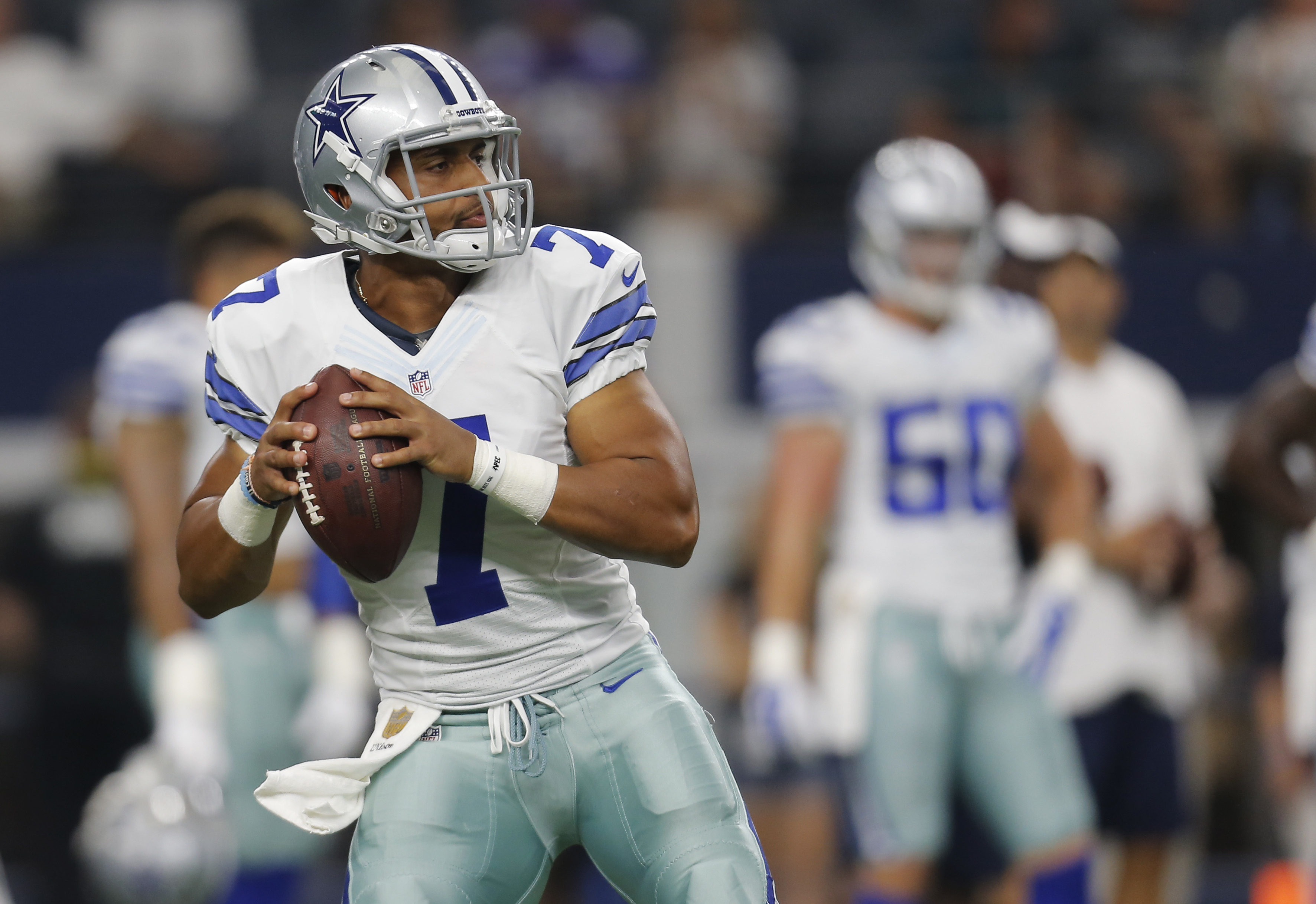 FILE - In this Saturday, Aug. 29, 2015 file photo, Dallas Cowboys quarterback Jameill Showers (7) warms up before a preseason NFL football game against the Minnesota Vikings  in Arlington, Texas. The Cowboys will give longer looks to a pair of young playe