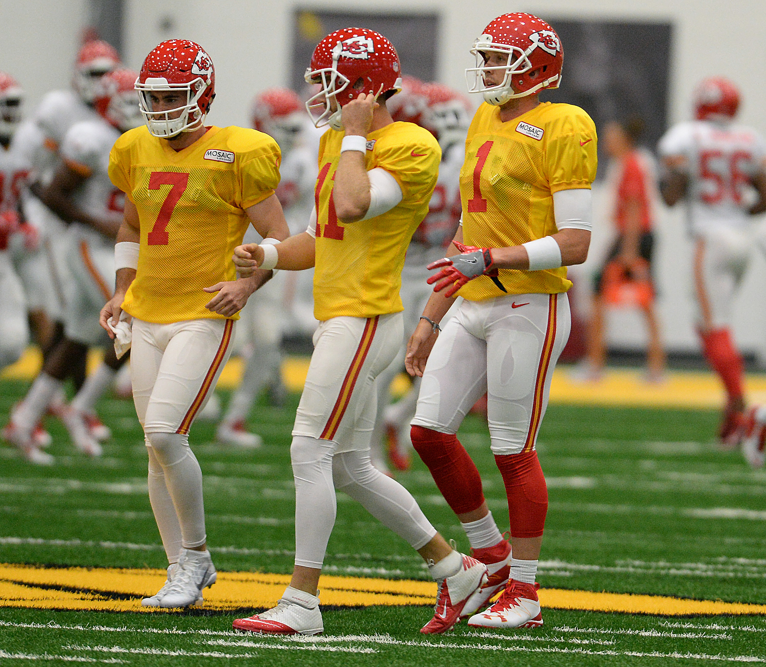 From left, Kansas City Chiefs quarterbacks Aaron Murray, Alex Smith and newly acquired Nick Foles practice at training Camp at the Griffon Indoor Sports Complex at Missouri Western State University Friday, Aug. 5, 2016 in St. Joseph, Mo. (Dougal Brownlie/