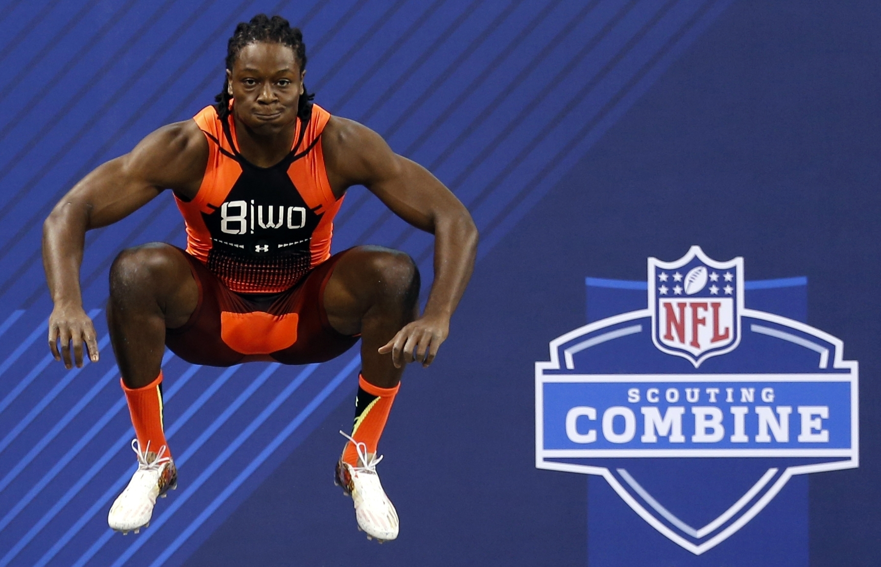 FILE - In this Feb. 21, 2015, file photo, Georgia wide receiver Chris Conley prepares to run the 40-yard dash at the NFL football scouting combine in Indianapolis. I know a couple of people in college who did the high jump and they have some springs, man,
