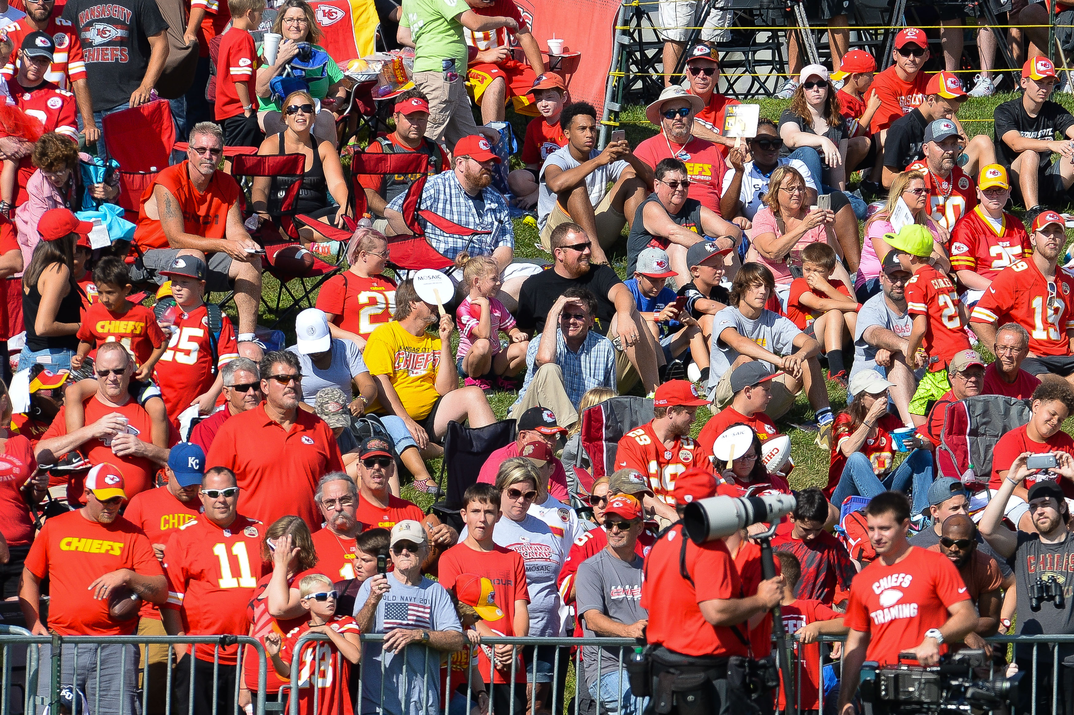 Fans watch from a hilltop as the Kansas City Chiefs' NFL football training camp Saturday, Aug. 6, 2016, in St. Joseph, Mo. (Dougal Brownlie/The St. Joseph News-Press via AP)
