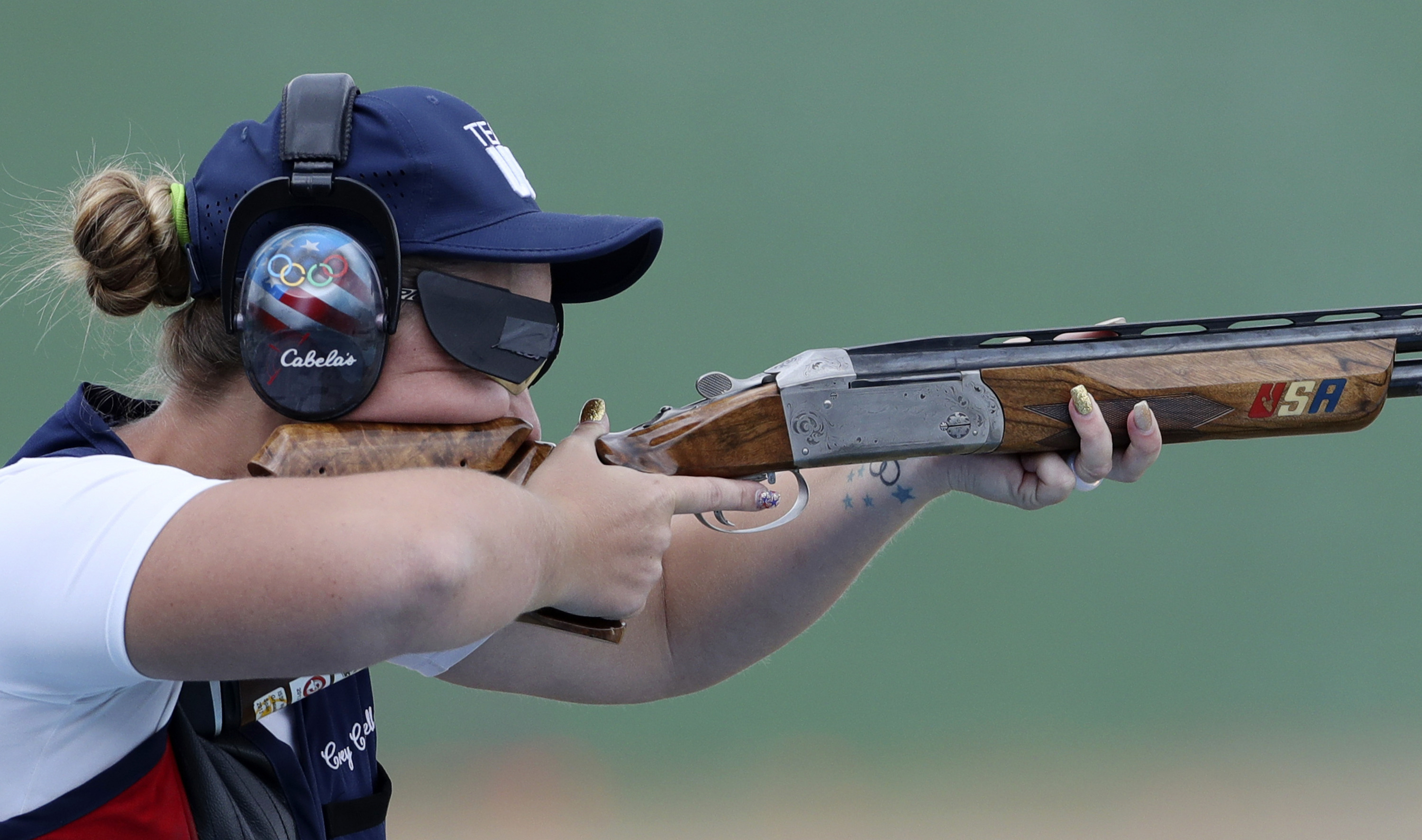 Corey Cogdell of the United States competes during the bronze medal match of the women's trap event at Olympic Shooting Center at the 2016 Summer Olympics in Rio de Janeiro, Brazil, Sunday, Aug. 7, 2016. Cogdell won the bronze medal. (AP Photo/Eugene Hosh