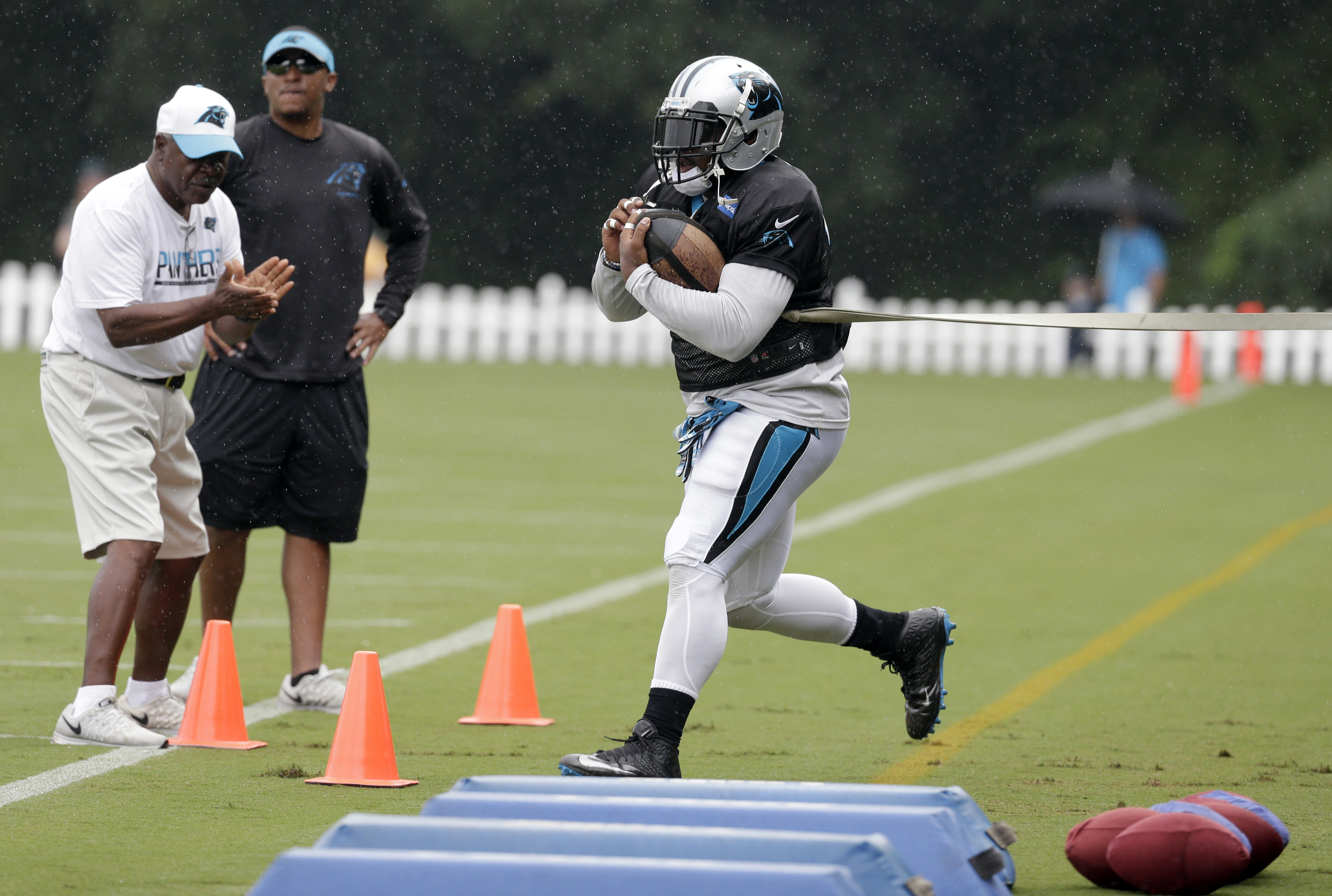 Carolina Panthers' Mike Tolbert runs a drill during an NFL training camp practice in Spartanburg, S.C., Monday, Aug. 8, 2016. (AP Photo/Chuck Burton)