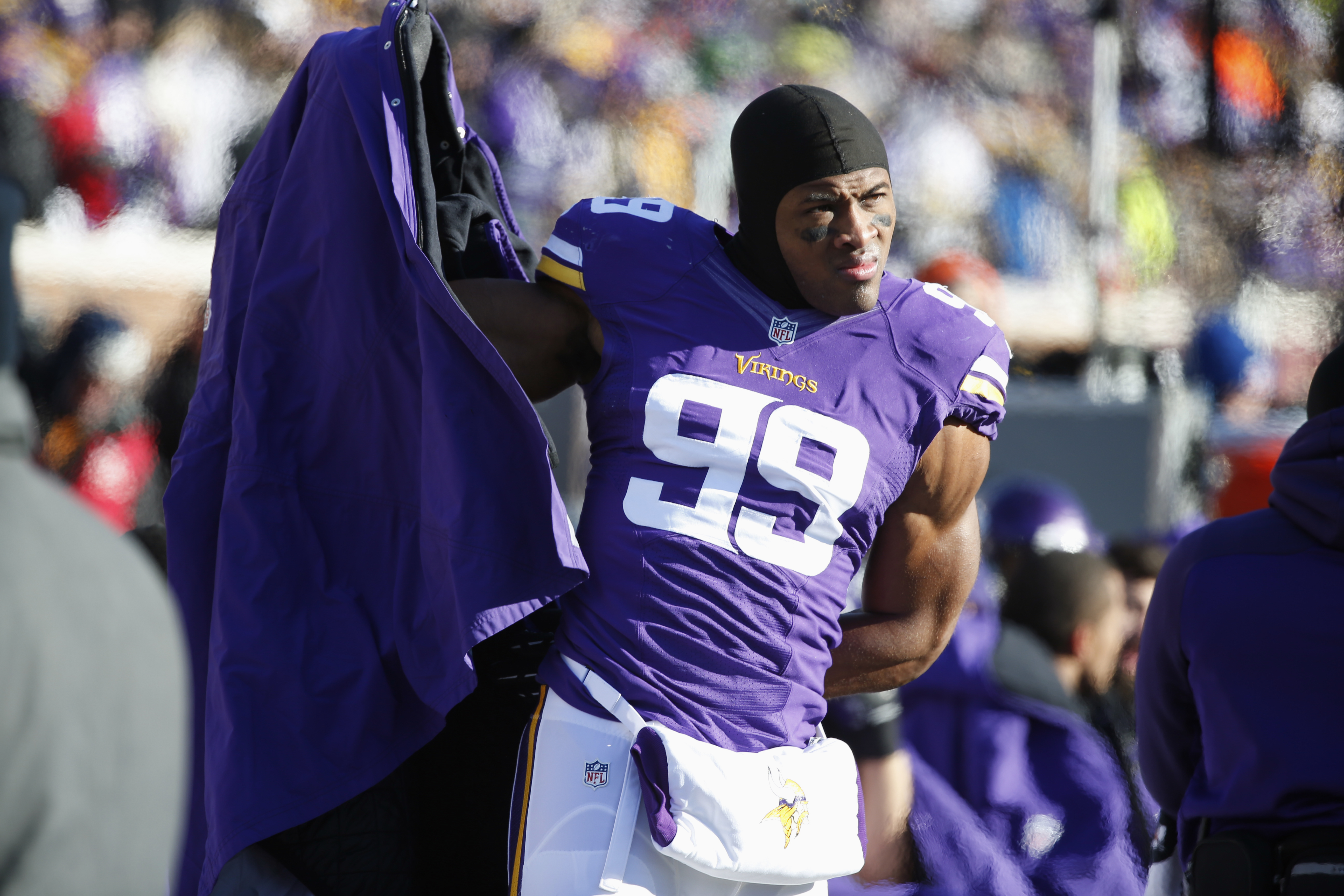 FILE - In this Jan. 10, 2016, file photo, Minnesota Vikings defensive end Danielle Hunter (99) watches from the sideline during the first half of an NFL wild-card football game against the Seattle Seahawks, in Minneapolis. As the youngest player in the NF