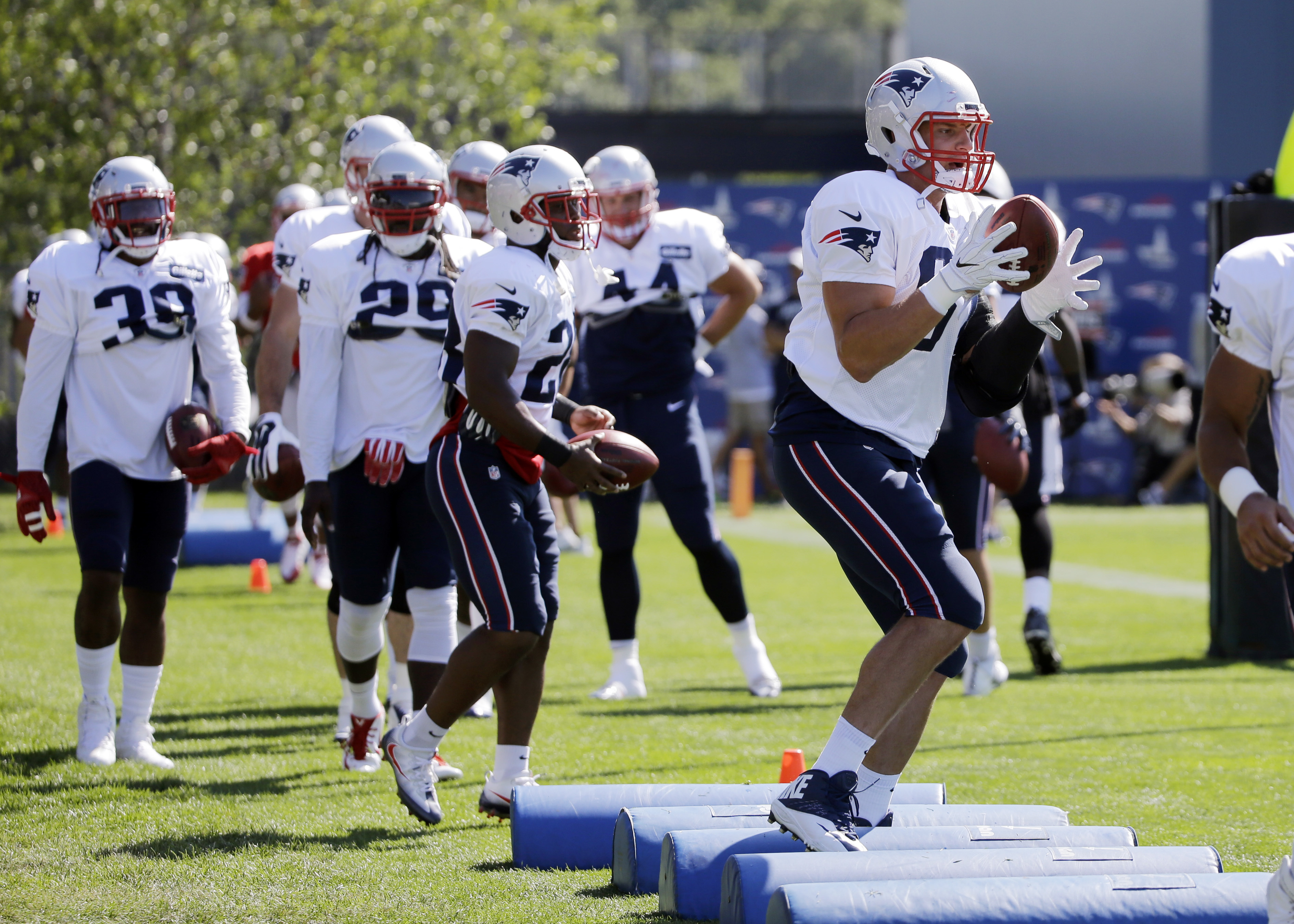 New England Patriots tight end Rob Gronkowski, right, performs a drill during football training camp, Tuesday, Aug. 9, 2016, in Foxborough, Mass. (AP Photo/Elise Amendola)
