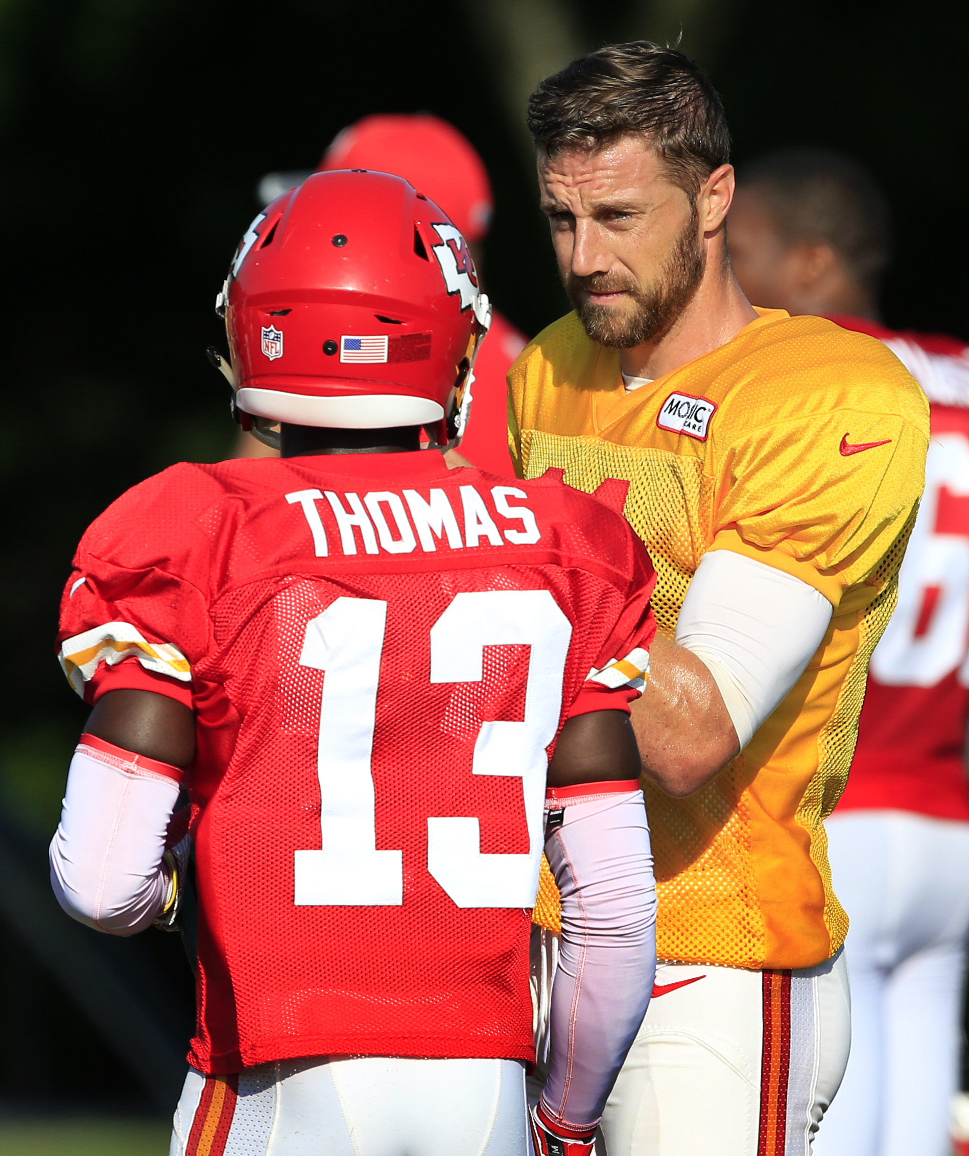 Kansas City Chiefs quarterback Alex Smith, right, talks with wide receiver De'Anthony Thomas (13) during NFL football training camp in St. Joseph, Mo., Wednesday, Aug. 10, 2016. (AP Photo/Orlin Wagner)