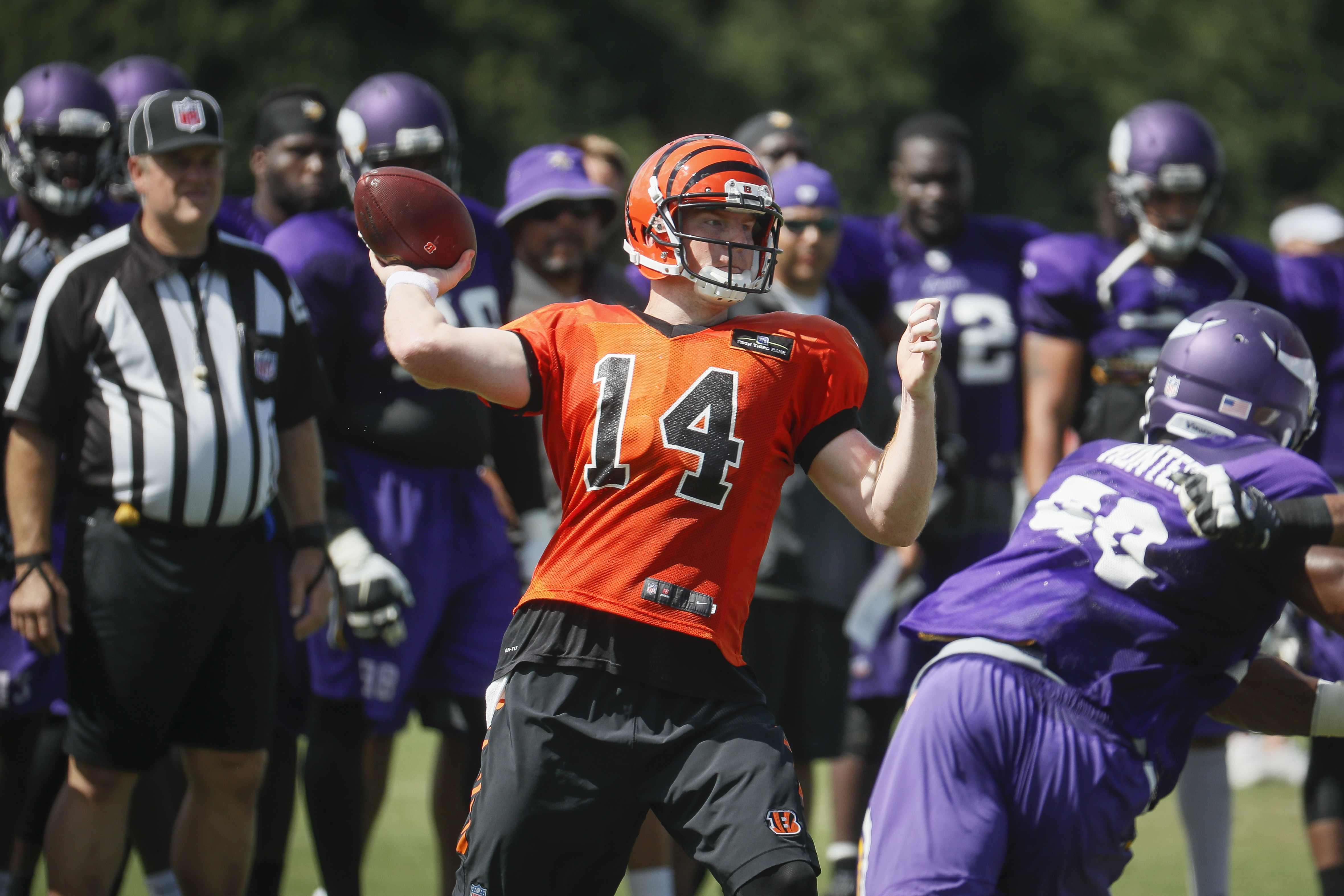 Cincinnati Bengals quarterback Andy Dalton throws during a joint NFL football practice with the Minnesota Vikings, Thursday, Aug. 11, 2016, in Cincinnati. (AP Photo/John Minchillo)