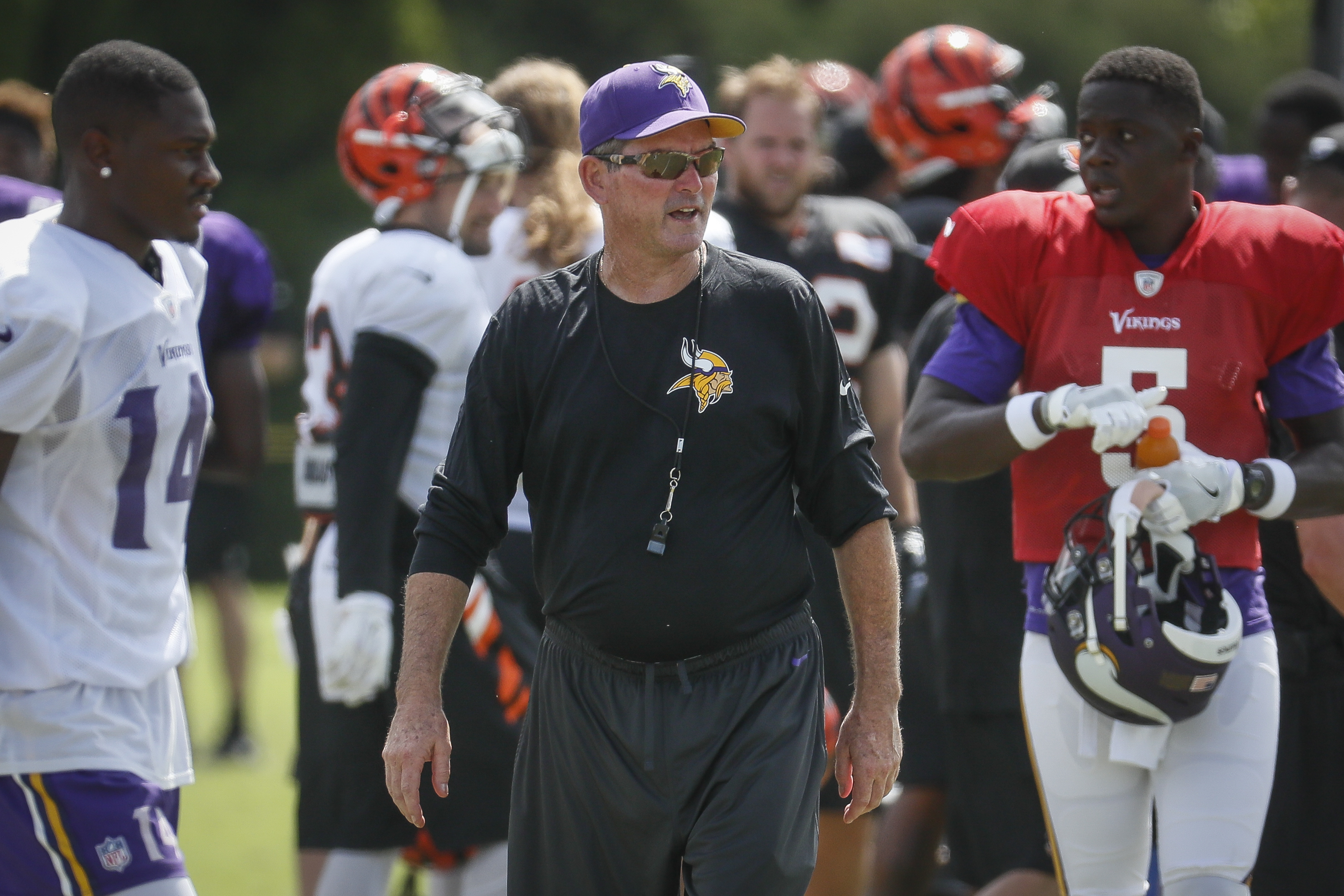 Minnesota Vikings head coach Mike Zimmer works the field during a joint NFL football practice with the Cincinnati Bengals, Thursday, Aug. 11, 2016, in Cincinnati. (AP Photo/John Minchillo)