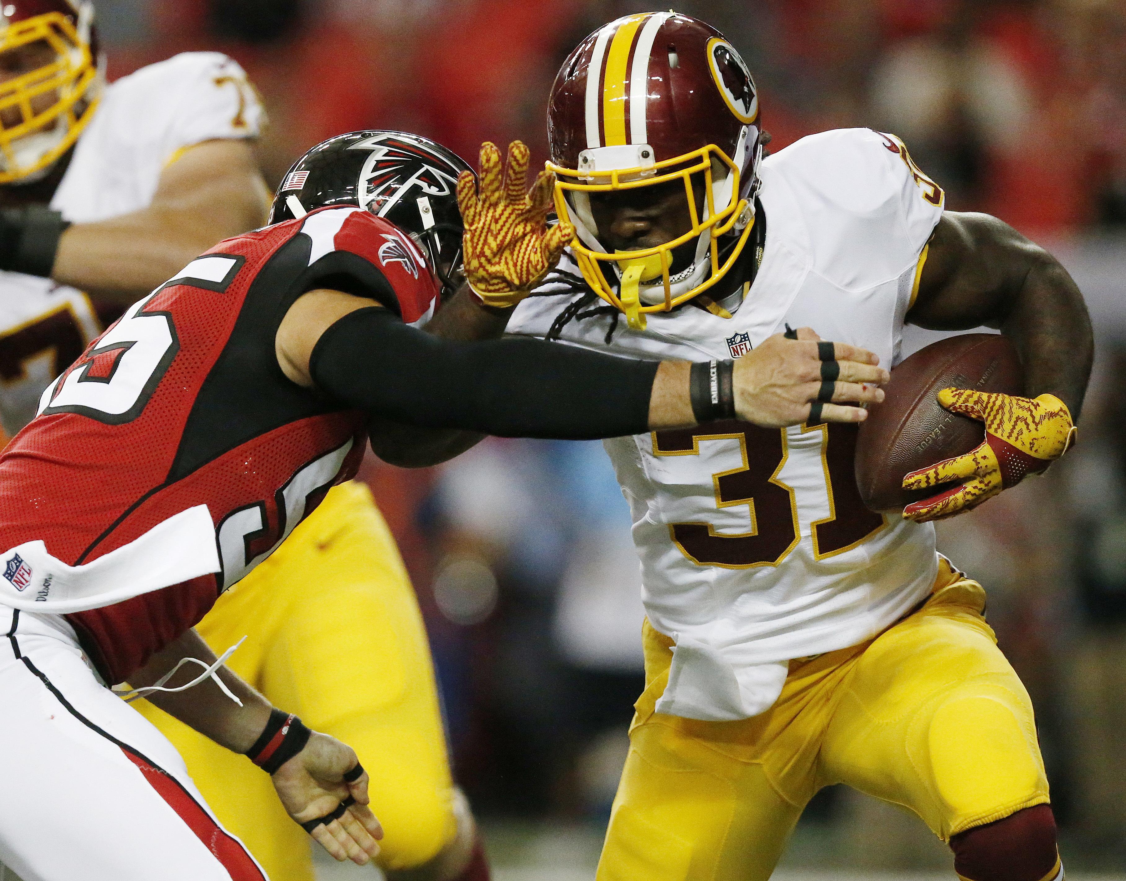 Washington Redskins running back Matt Jones (31) runs against Atlanta Falcons middle linebacker Paul Worrilow (55) during the first half of a preseason NFL football game, Thursday, Aug. 11, 2016, in Atlanta. (AP Photo/Brynn Anderson)