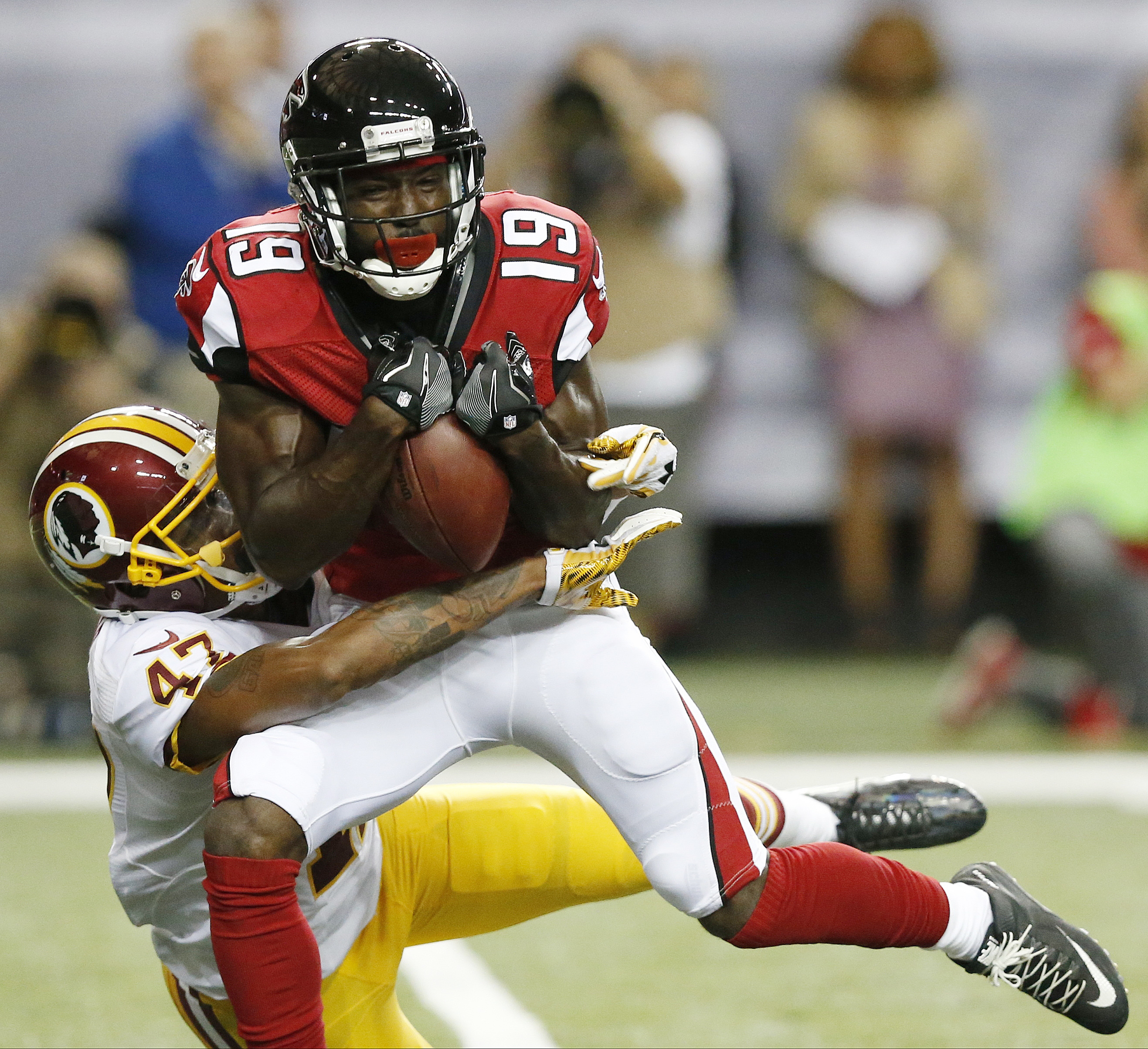 Atlanta Falcons wide receiver Aldrick Robinson (19) makes a catch against Washington Redskins cornerback Quinton Dunbar (47) during the first half of a preseason NFL football game, Thursday, Aug. 11, 2016, in Atlanta. (AP Photo/Brynn Anderson)