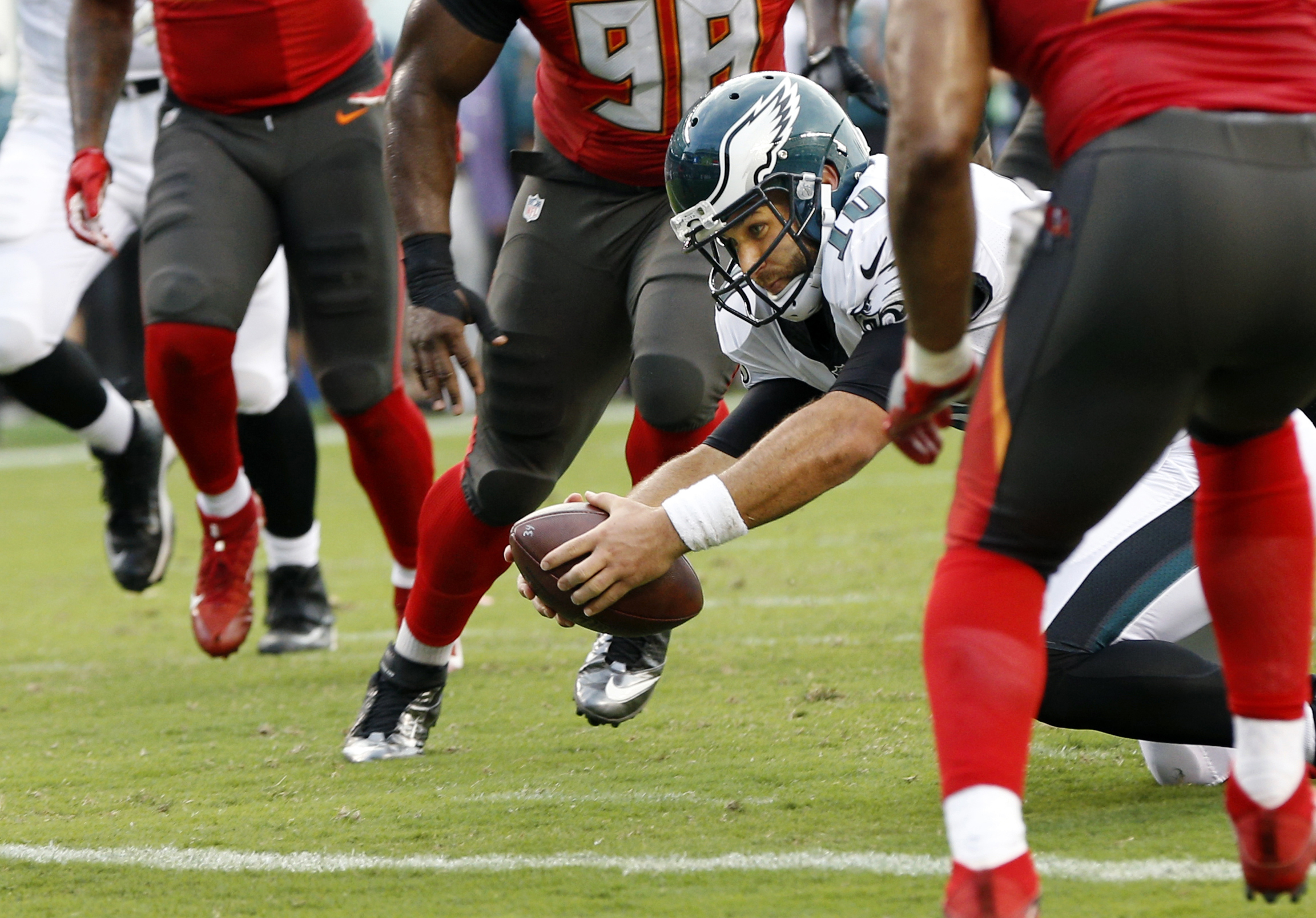 Philadelphia Eagles quarterback Chase Daniel (10) dives between Tampa Bay Buccaneers defenders for a touchdown during the first half of a preseason NFL football game Thursday, Aug. 11, 2016, in Philadelphia. (AP Photo/Chris Szagola)