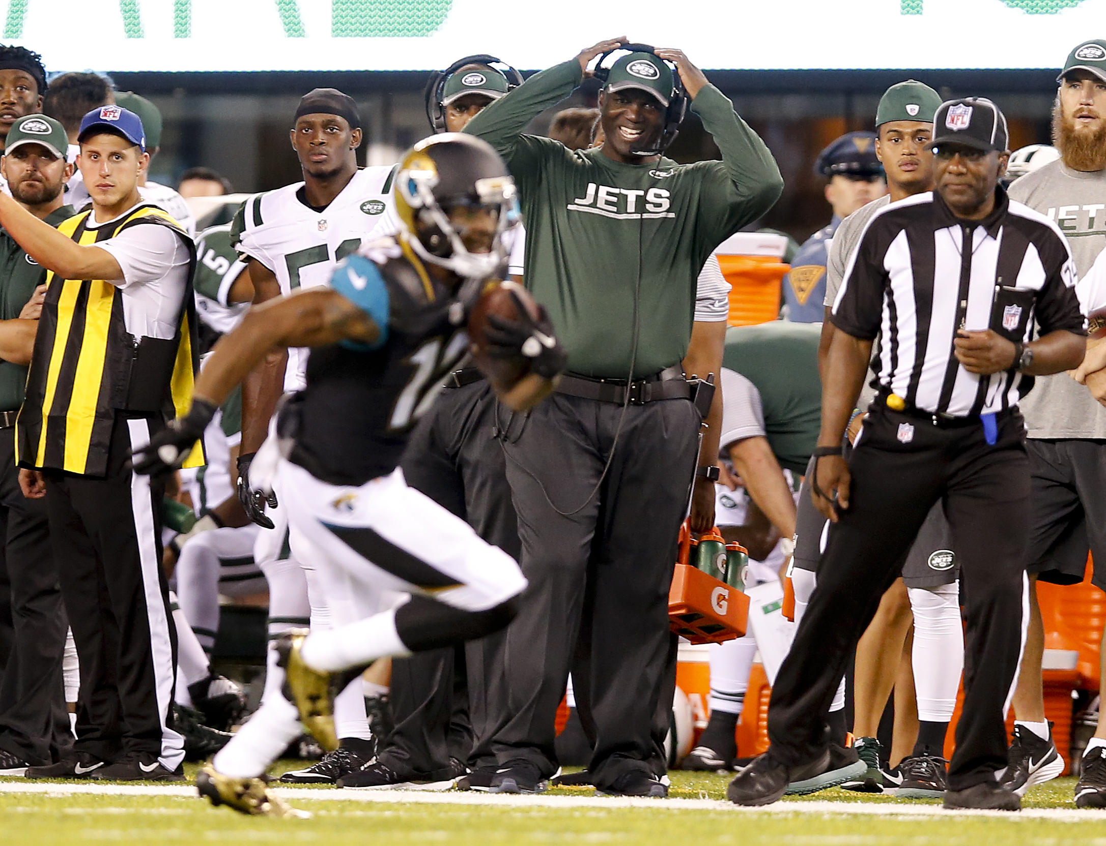 New York Jets head coach Todd Bowles reacts as Jacksonville Jaguars wide receiver Tony Washington (12) runs the ball up field during the second quarter of an NFL football game, Thursday, Aug. 11, 2016, in East Rutherford, N.J. (AP Photo/Kathy Willens)