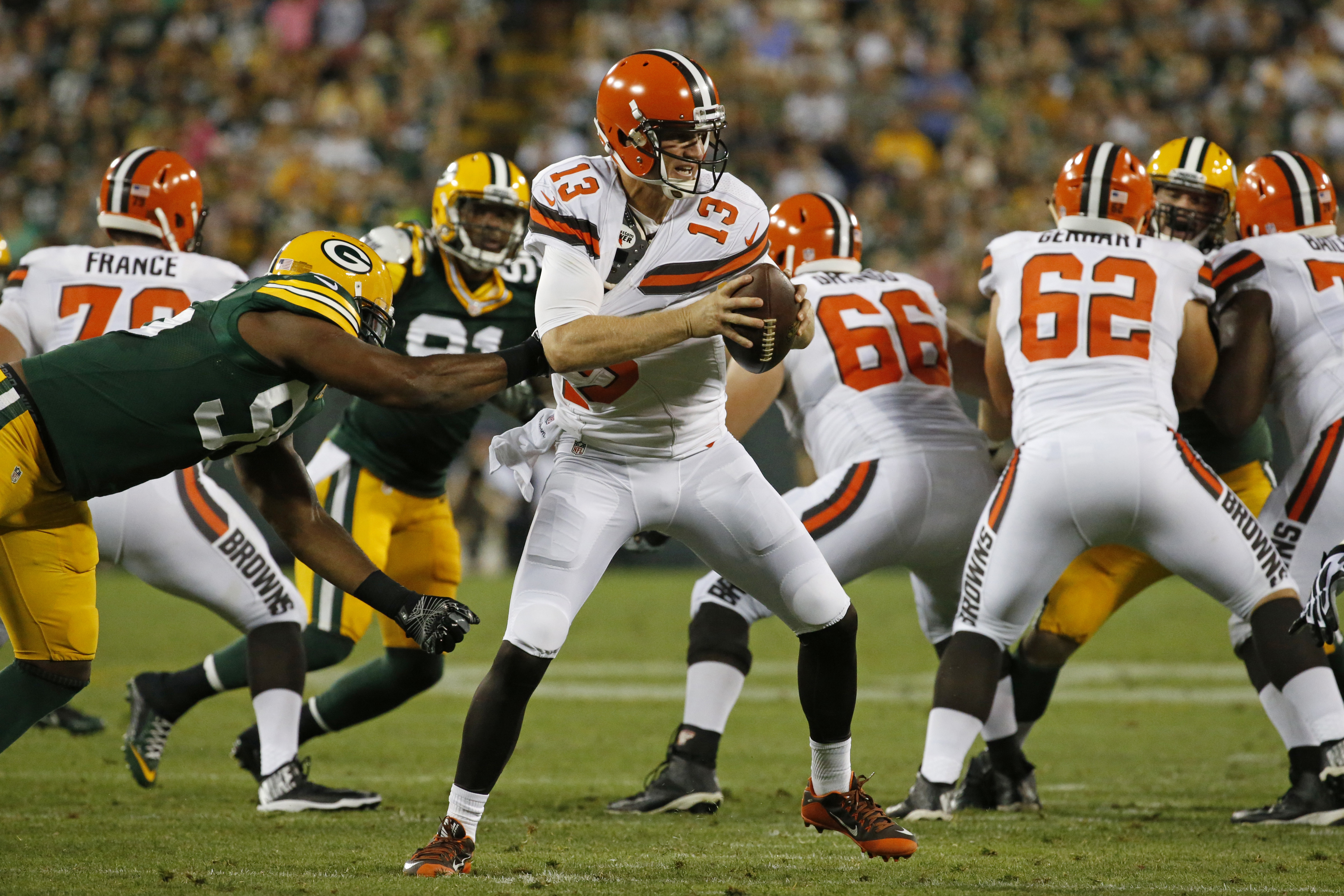 Green Bay Packers defensive end Datone Jones (95) sacks Cleveland Browns quarterback Josh McCown (13) in the first half of an NFL preseason football game in Green Bay, Wis., Friday, Aug. 12, 2016. (AP Photo/Mike Roemer)