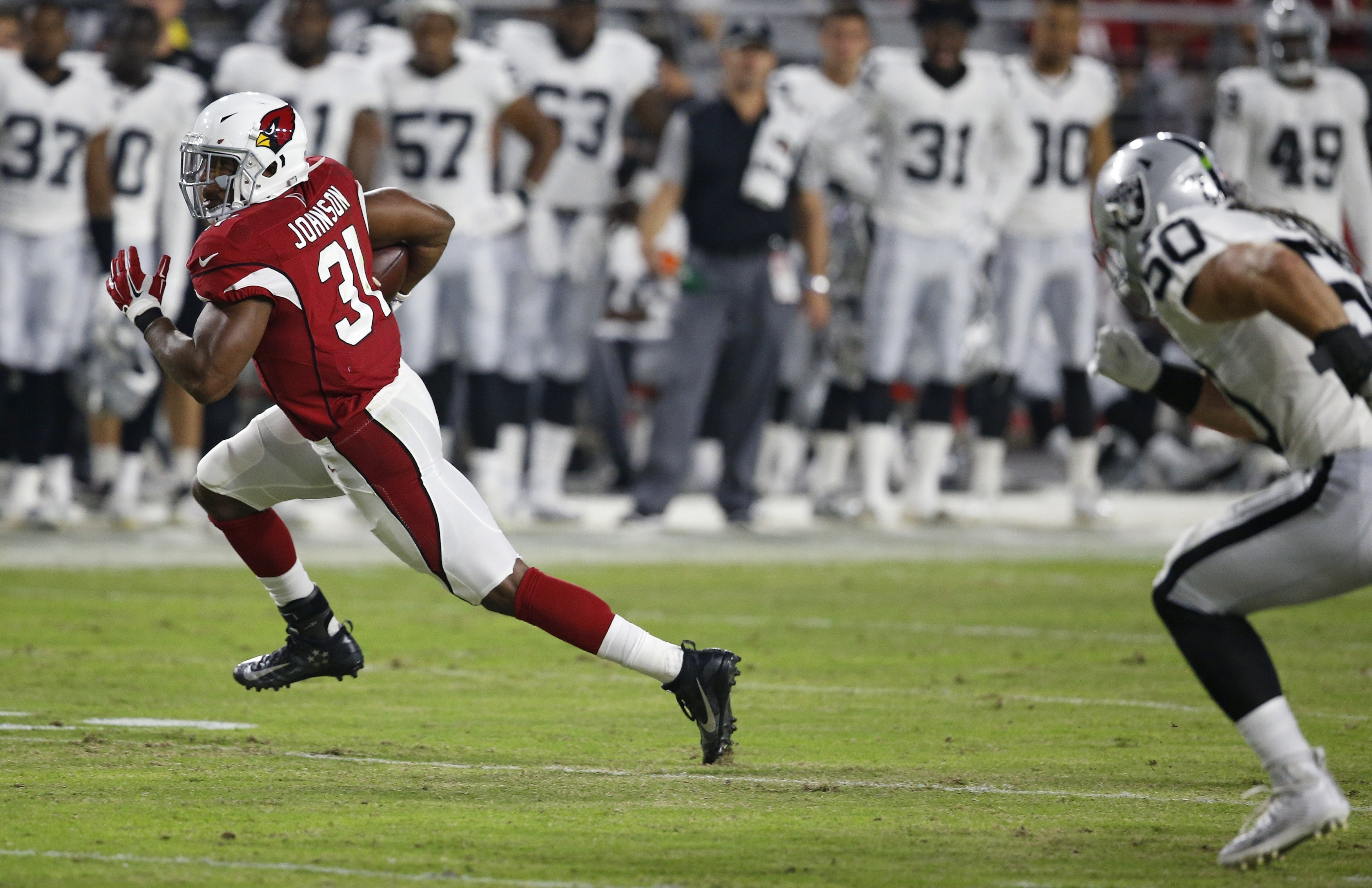 Arizona Cardinals running back David Johnson (31) runs in the open field as he gets past Oakland Raiders' Ben Heeney (50) during the first half of an NFL preseason football game Friday, Aug. 12, 2016, in Glendale, Ariz. (AP Photo/Ross D. Franklin)