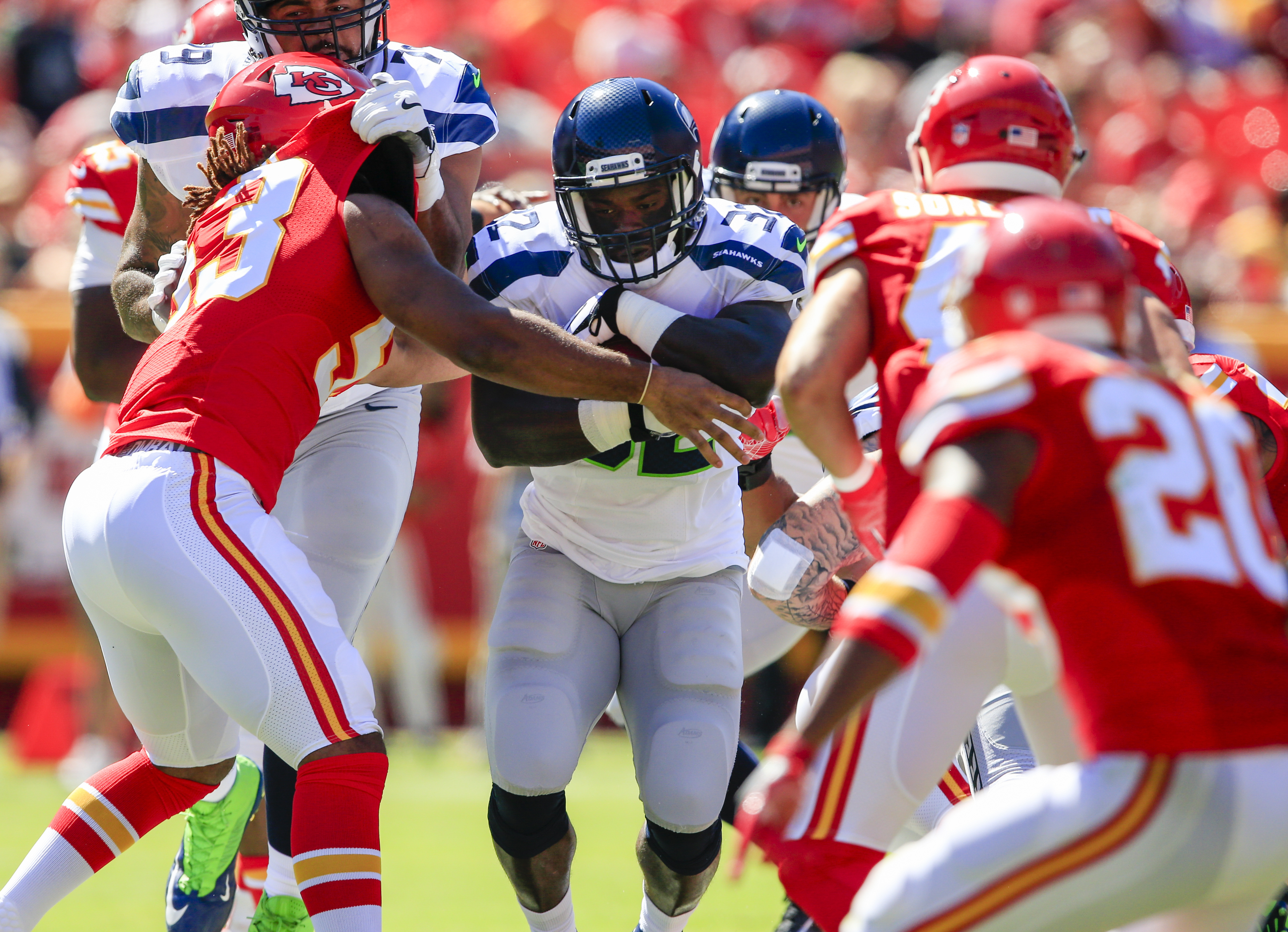 Kansas City Chiefs linebacker Ramik Wilson (53) tries to tackle Seattle Seahawks running back Christine Michael (32) during the first half of an NFL preseason football game in Kansas City, Mo., Saturday, Aug. 13, 2016. (AP Photo/Orlin Wagner)