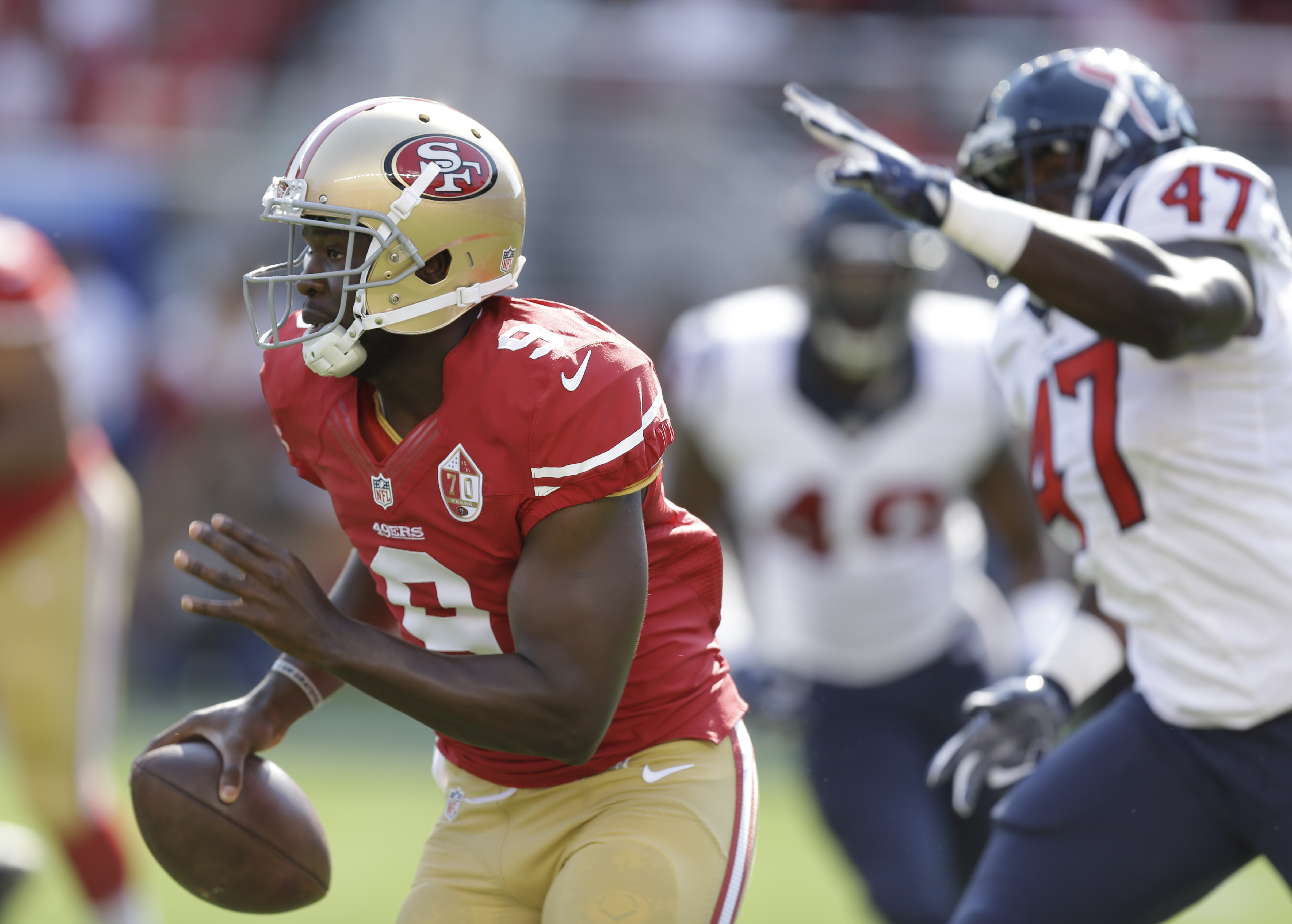 San Francisco 49ers quarterback Thad Lewis runs with the ball as Houston Texans linebacker Eric Lee (47) gives chase during the first half of an NFL preseason football game Sunday, Aug. 14, 2016, in Santa Clara, Calif. (AP Photo/Ben Margot)