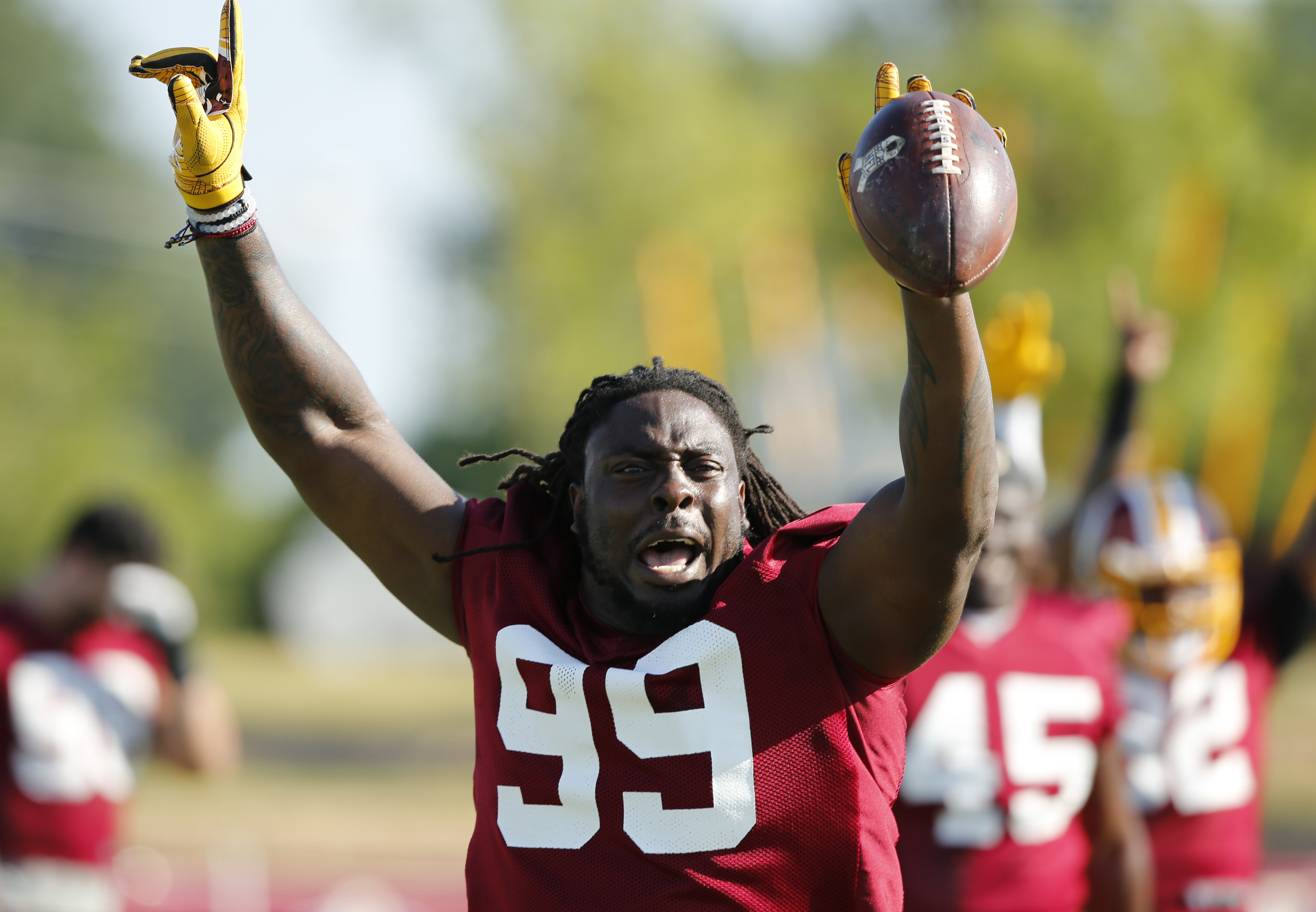 Washington Redskins defensive end Ricky Jean Francois (99) celebrates catching a practice punt signifying the end of practice during the last day of the Washington Redskins NFL football teams training camp in Richmond, Va., Monday, Aug. 15, 2016. (AP Phot