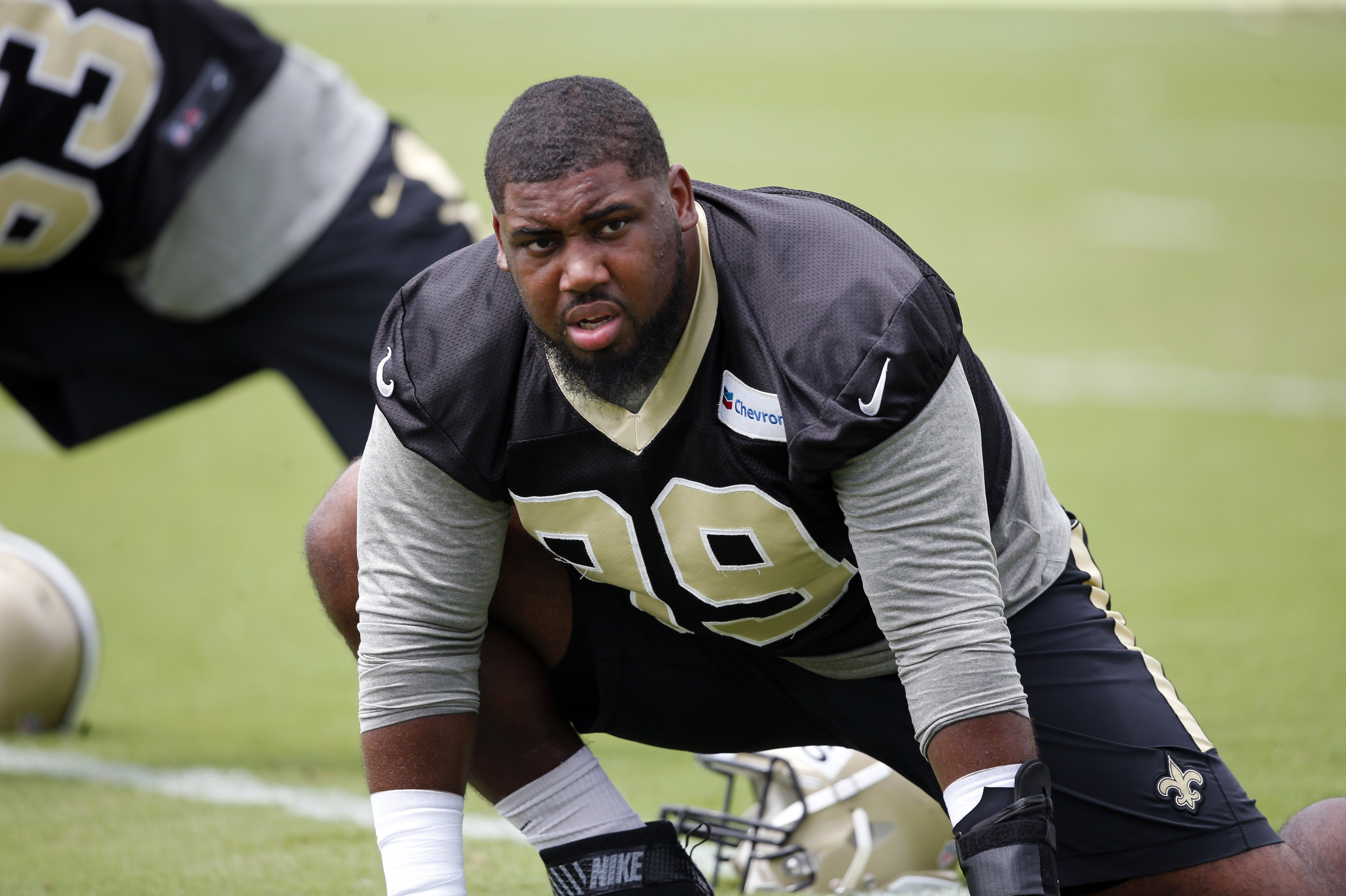 New Orleans Saints defensive tackle Sheldon Rankins (99) stretches during the NFL football team's minicamp in Metairie, La., Tuesday, June 14, 2016. (AP Photo/Gerald Herbert)