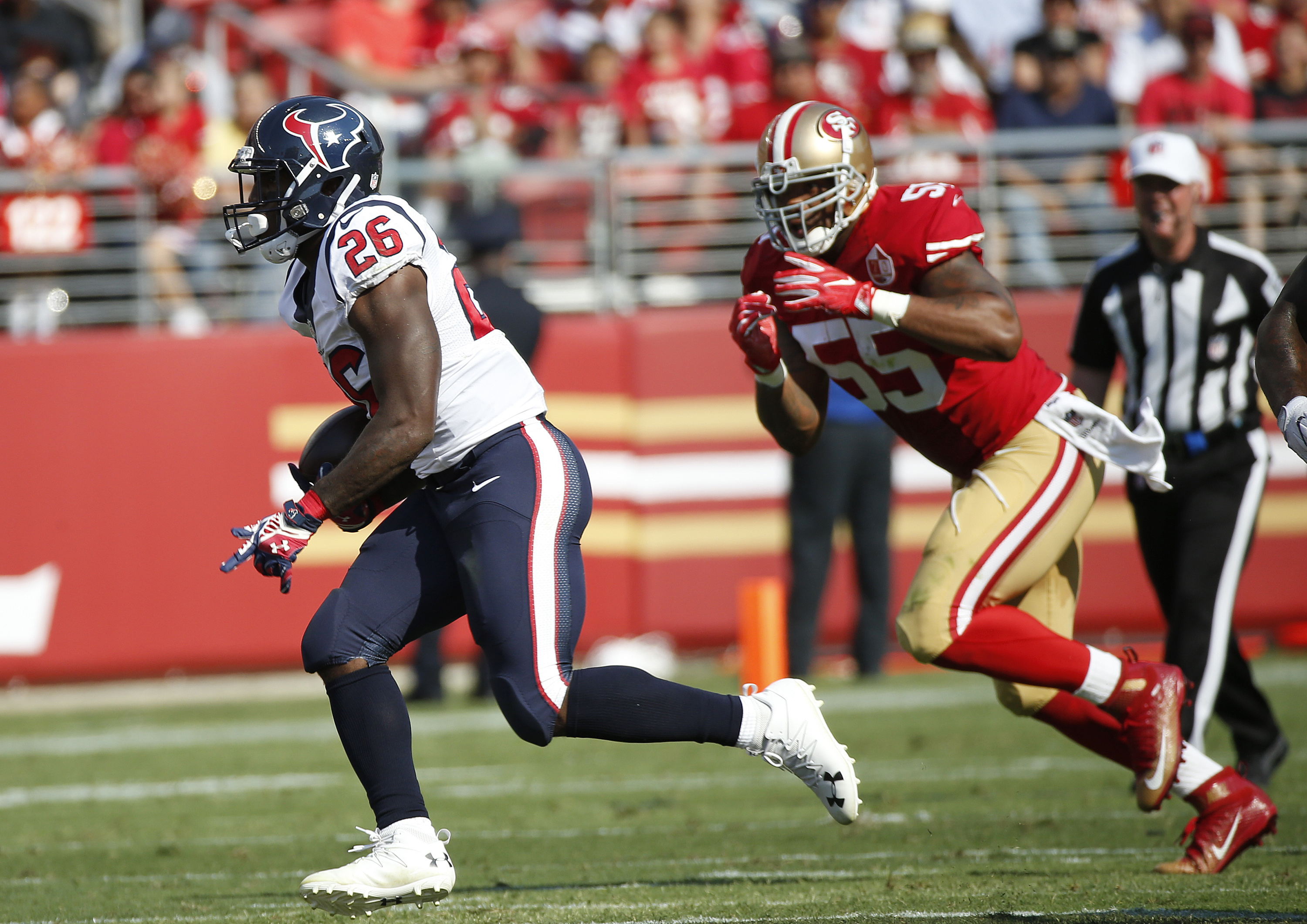 FILE - In this Aug. 14, 2016, file photo, Houston Texans running back Lamar Miller, left, carries the ball past San Francisco 49ers outside linebacker Ahmad Brooks, right, during the first half of an NFL preseason football game, in Santa Clara, Calif. Mil