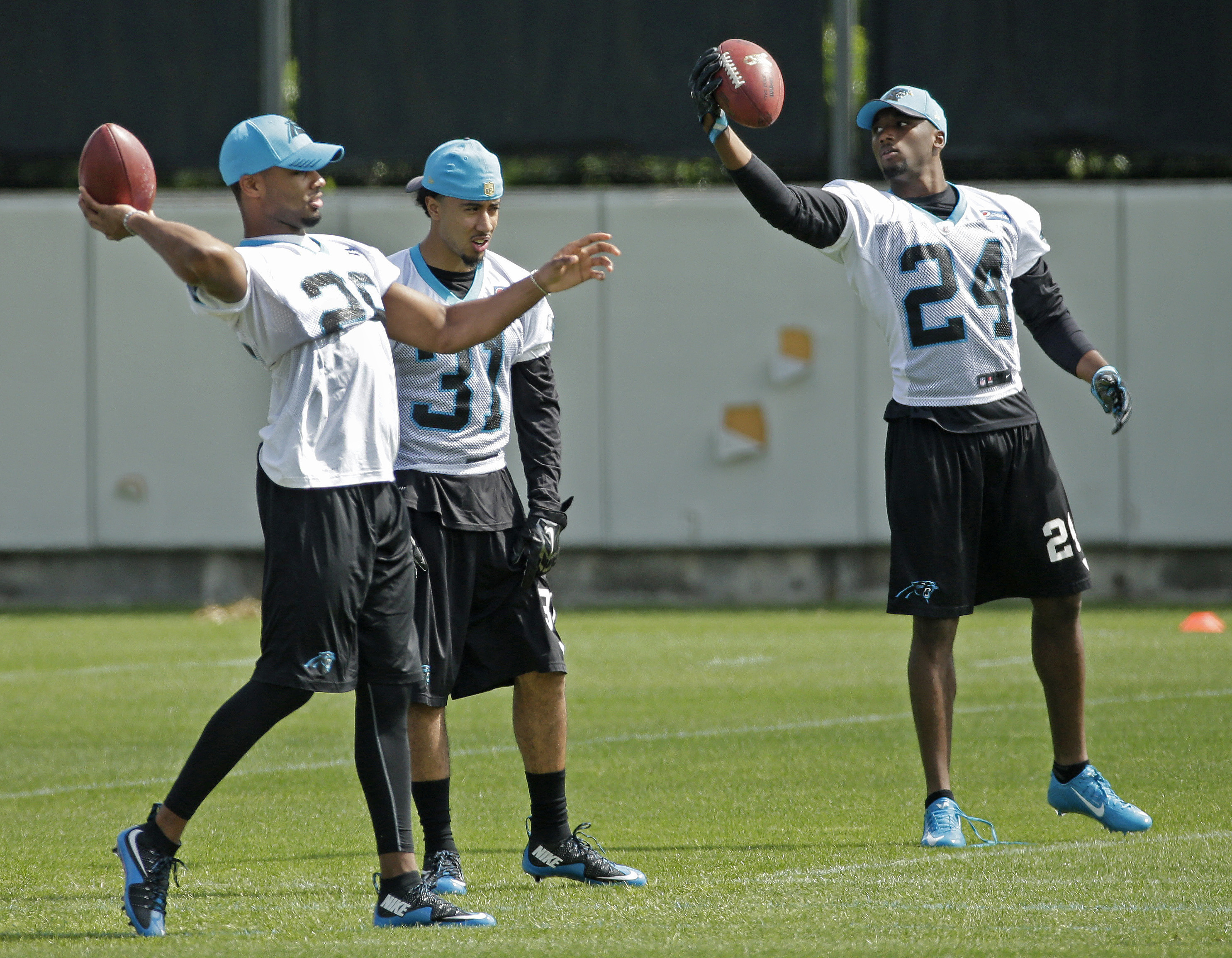 FILE - In this May 13, 2016, file photo, Carolina Panthers rookie draft picks, from left, Daryl Worley, Zack Sanchez and James Bradberry warm up during an NFL football practice in Charlotte, N.C. Panthers rookie cornerbacks James Bradberry and Daryl Worle