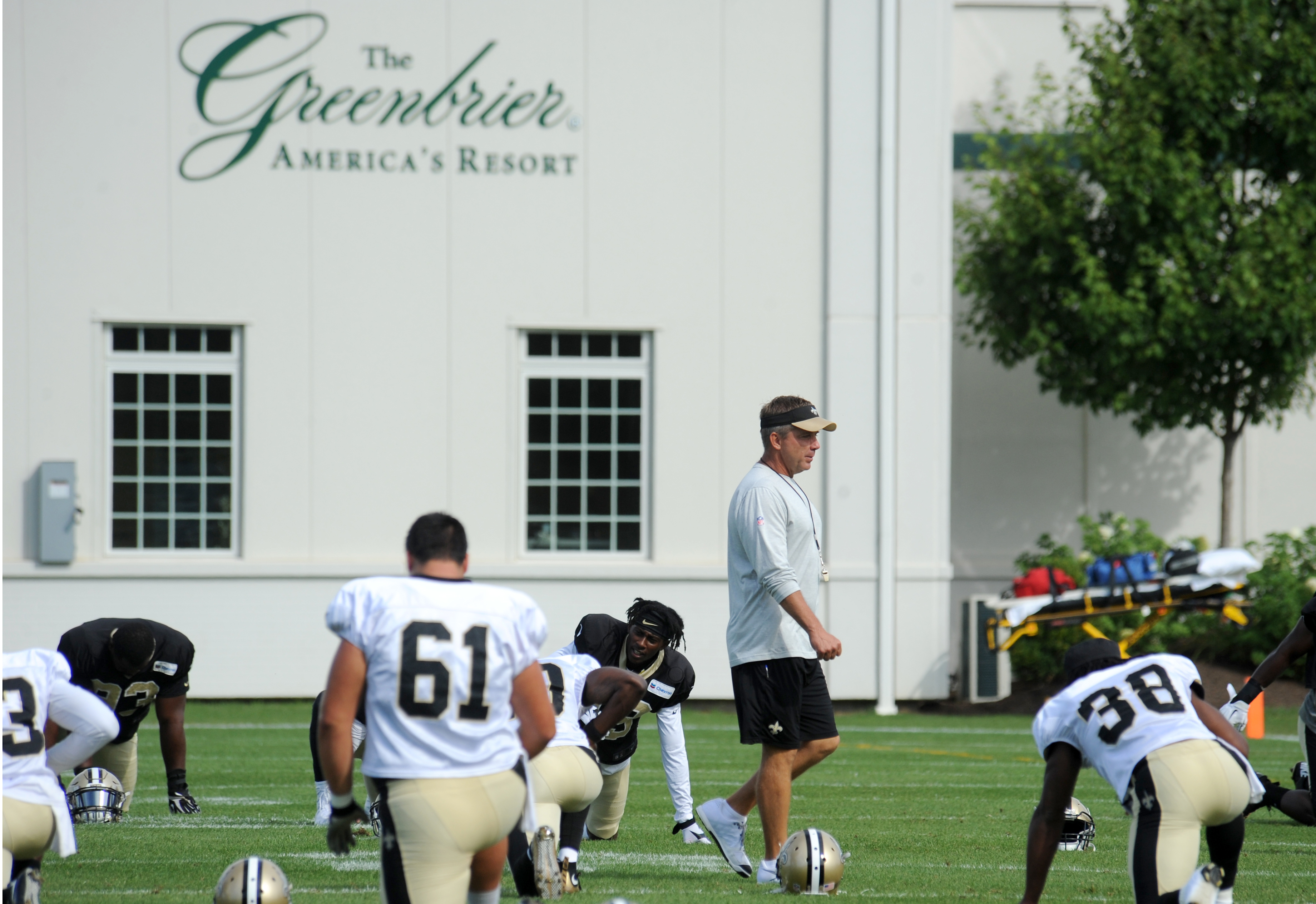 FILE - In this Aug. 15, 2016, file photo, New Orleans Saints head coach Sean Payton walks among the players during the NFL football teams training camp at the Greenbrier Resort in White Sulphur Springs, W. Va. The Saints' three-year deal to hold the bulk