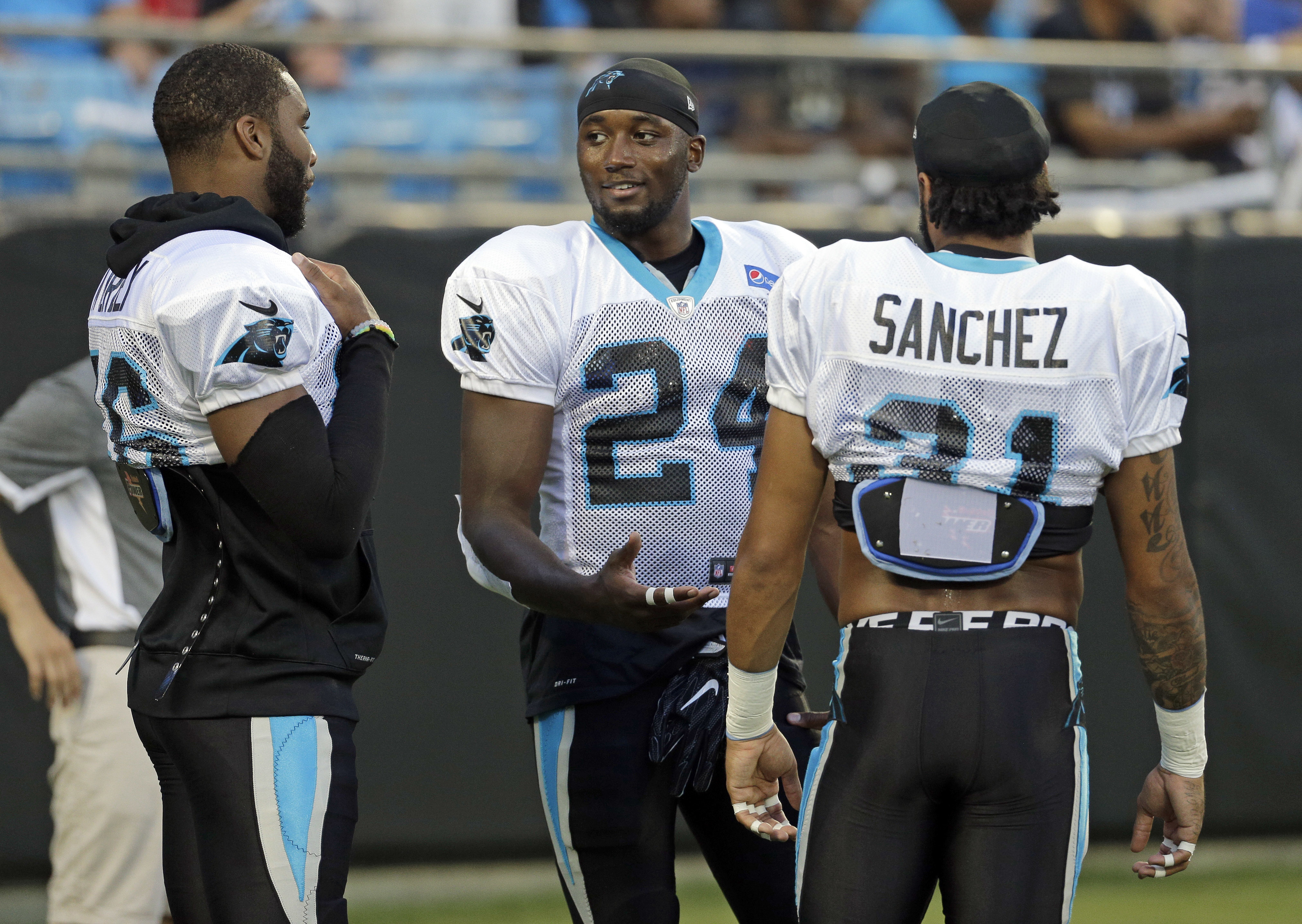 In this photo taken Aug. 5, 2016,  Carolina Panthers' James Bradberry, center, talks with Zack Sanchez, right, and Daryl Worley, left, at their annual Fan Fest practice during NFL training camp in Charlotte, N.C. As the Panthers wrap up training camp at W