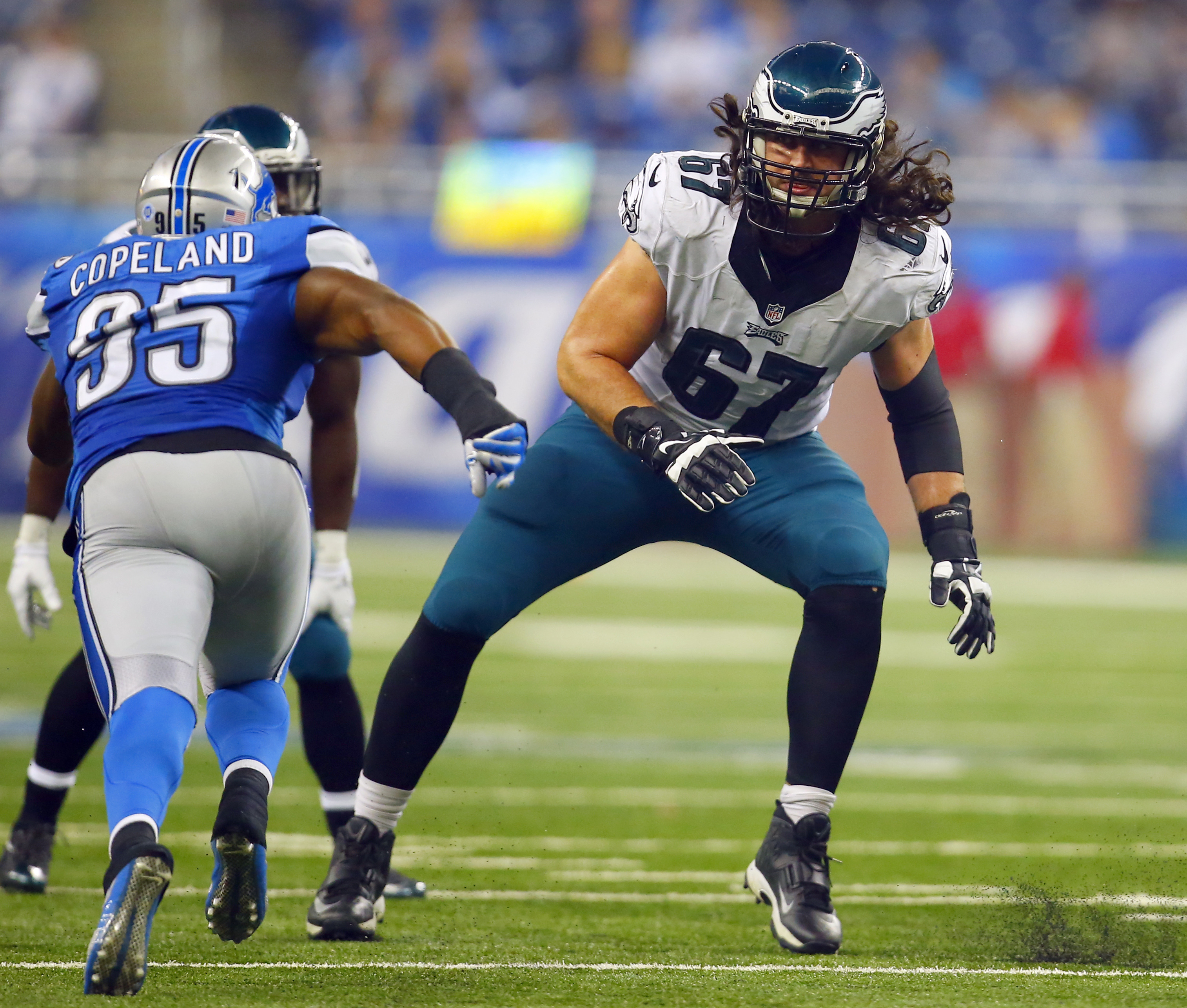 FILE - In this Nov. 26, 2015, file photo, then-Philadelphia Eagles offensive tackle Dennis Kelly (67) sets to block Detroit Lions linebacker Brandon Copeland (95) during an NFL football game, in Detroit. The Tennessee Titans' offensive line features three