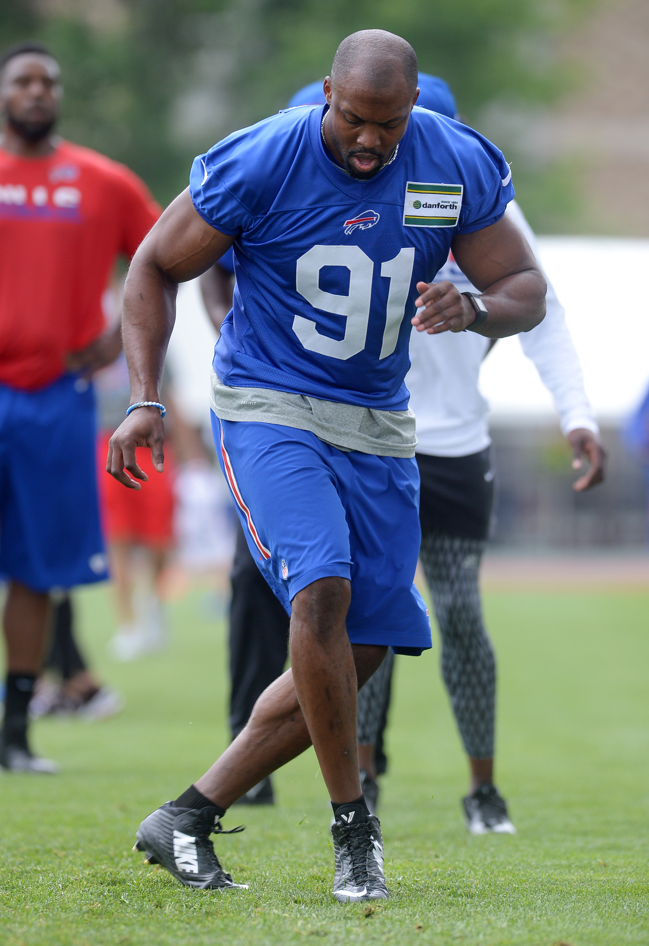 Buffalo Bills linebacker Manny Lawson (91) participates in drills during practice at the NFL football team training camp in Pittsford, N.Y., Monday, Aug. 1, 2016. (AP Photo/Adrian Kraus)