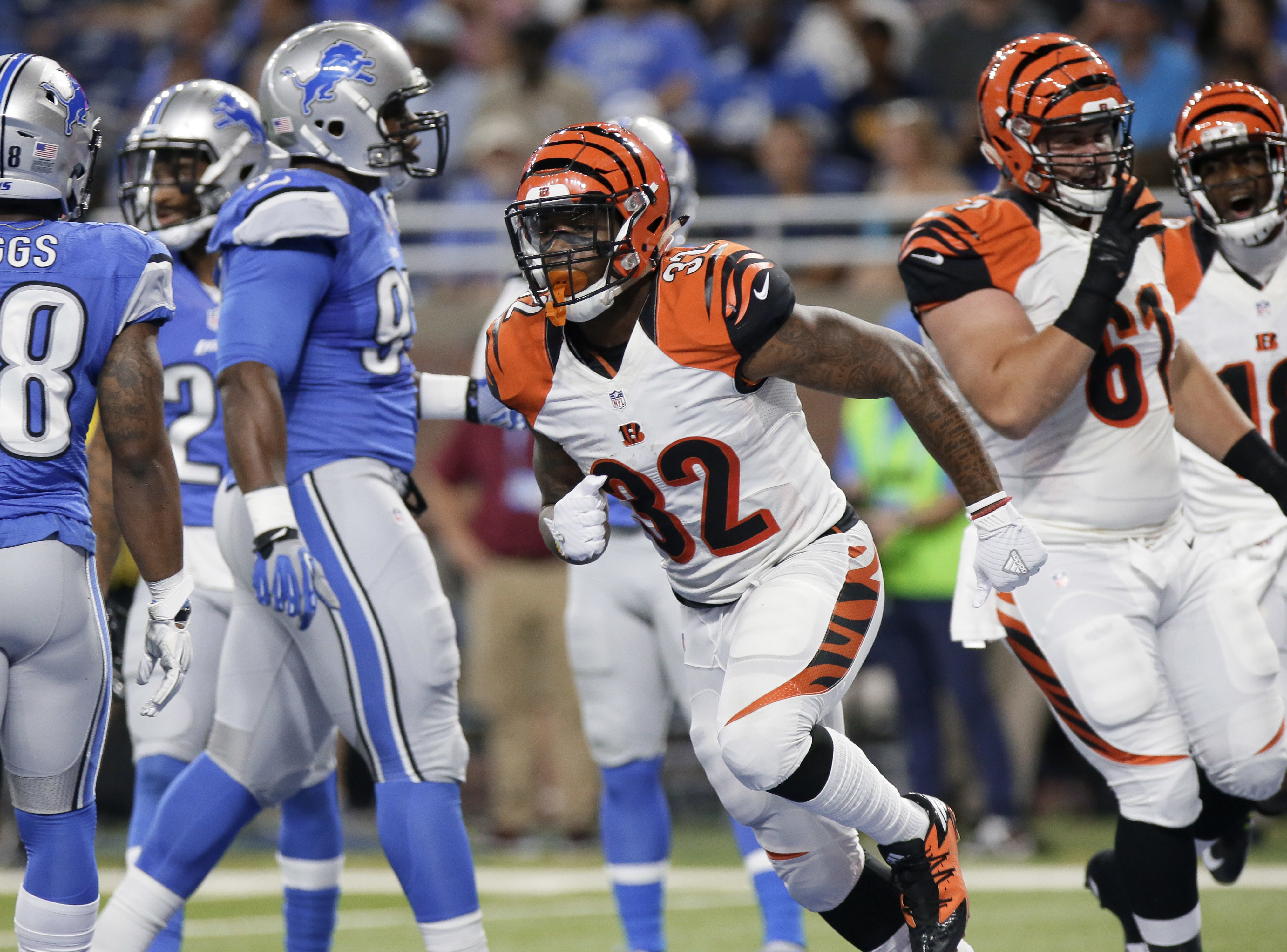 Cincinnati Bengals running back Jeremy Hill (32) celebrates his 9-yard rushing touchdown against the Detroit Lions in the first half of an NFL preseason football game in Detroit, Thursday, Aug. 18, 2016. (AP Photo/Duane Burleson)