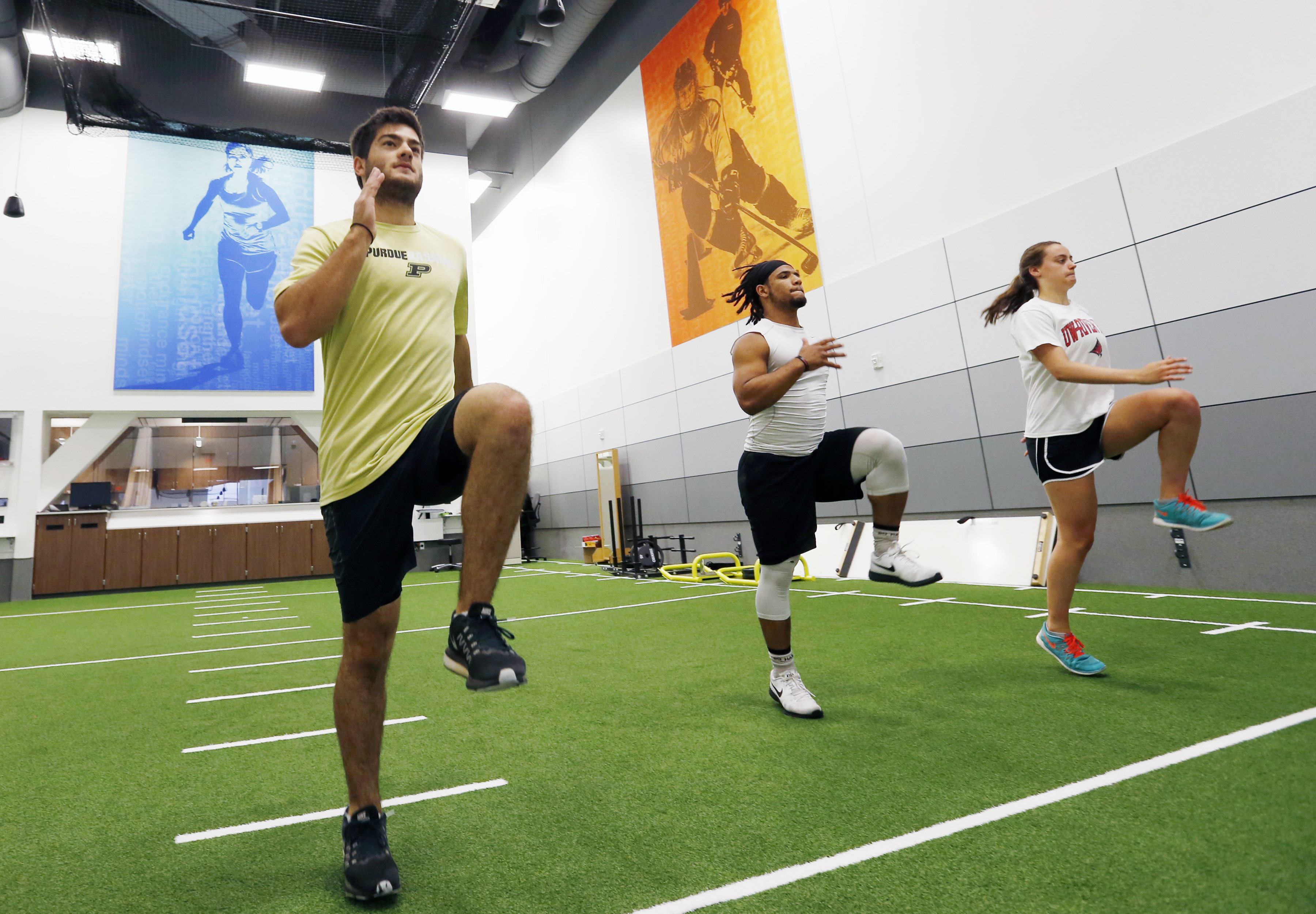 In this July 6, 2016 photo, from left, Stephen Kalina, Jaden Huff and Haley Nielsen go through workouts at the Mayo Clinic in Minneapolis. Mayo's new facility for high-level conditioning with noted performance trainer EXOS isn't just for elite athletes an