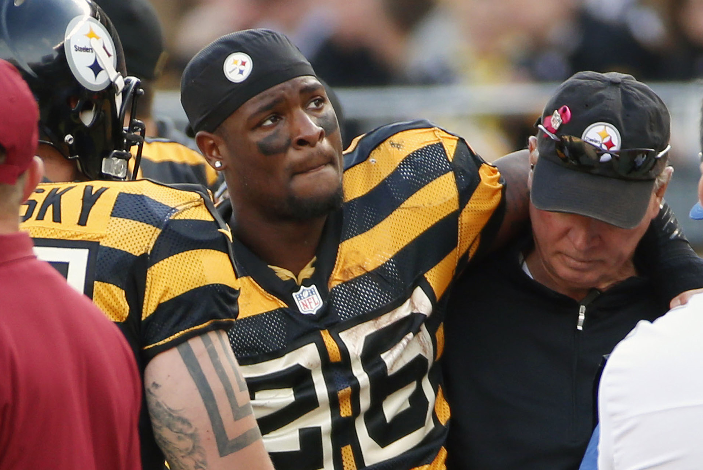 FILE - In this Nov. 1, 2015, file photo, Pittsburgh Steelers running back Le'Veon Bell (26) is helped from the field after being injured in an NFL football game against the Cincinnati Bengals in Pittsburgh. Bell is ready to serve his suspension and move o
