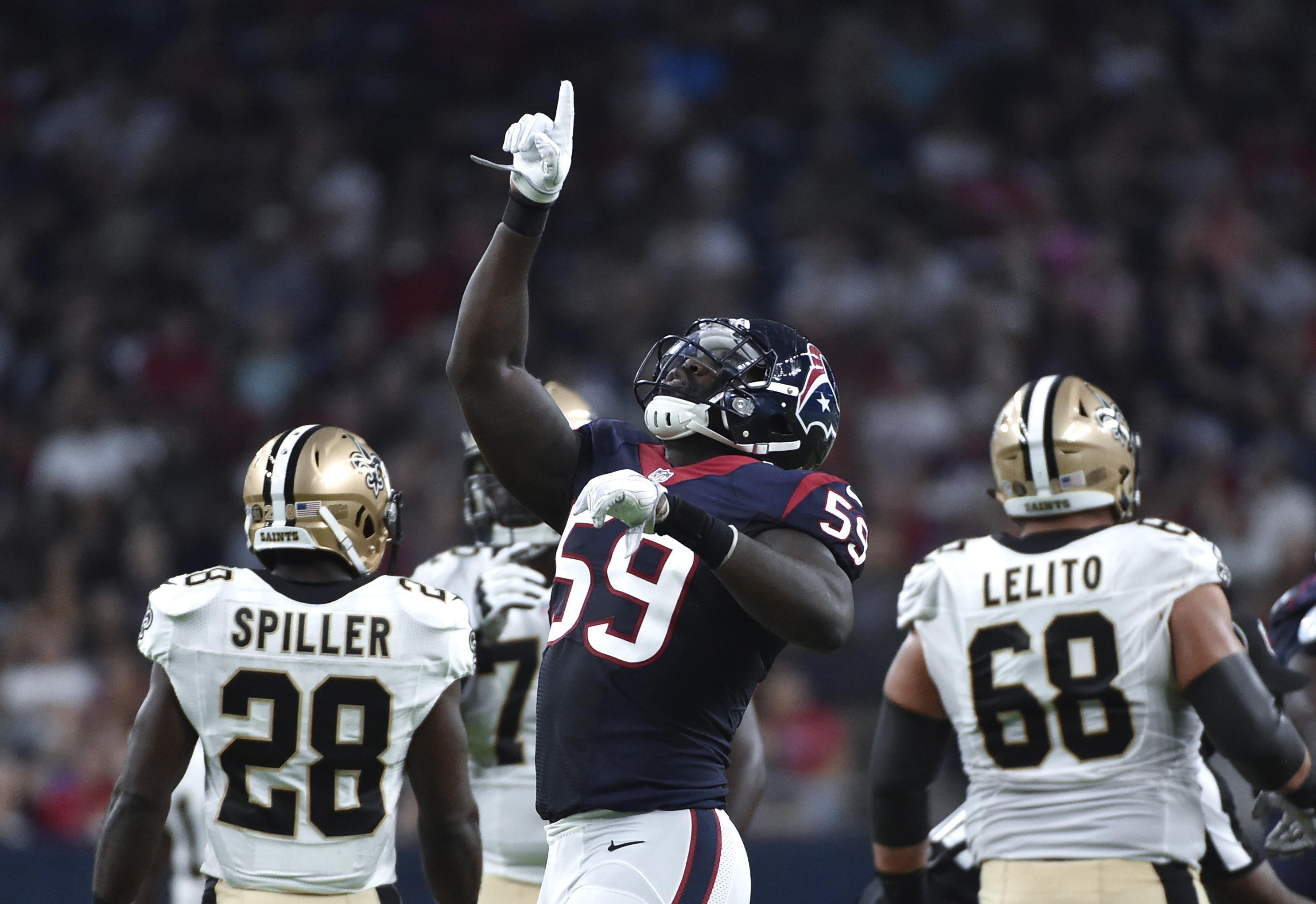 Houston Texans outside linebacker Whitney Mercilus (59) celebrates applying pressure to New Orleans Saints quarterback Drew Brees in the first half of an NFL preseason football game in Houston, Saturday, Aug. 20, 2016. (AP Photo/Eric Christian Smith)
