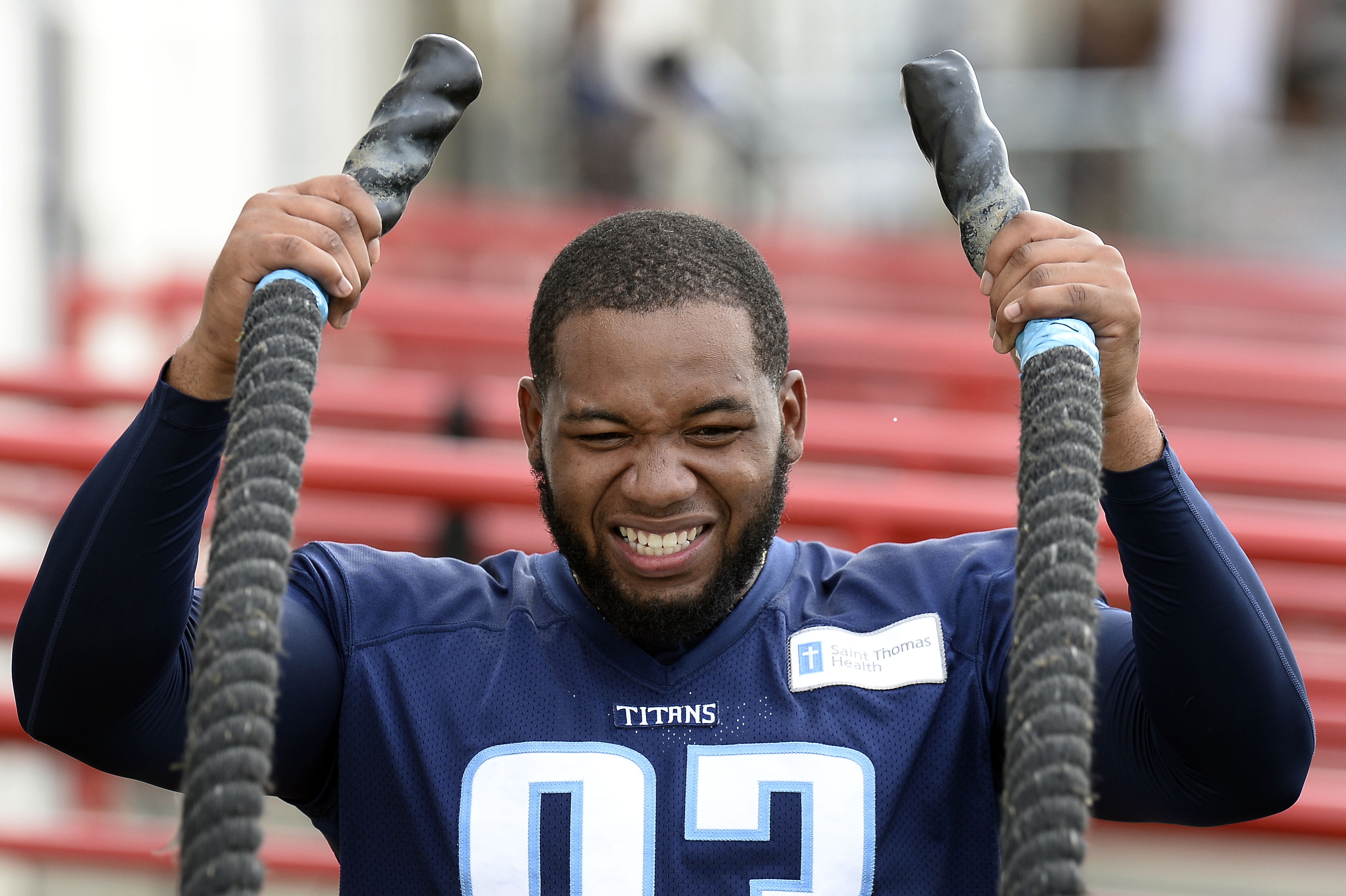 FILE -- In this Aug. 4, 2016 file photo, Tennessee Titans outside linebacker Kevin Dodd does a conditioning drill with heavy ropes during NFL football training camp in Nashville, Tenn. Dodd is looking forward to the opportunity to make his debut Saturday