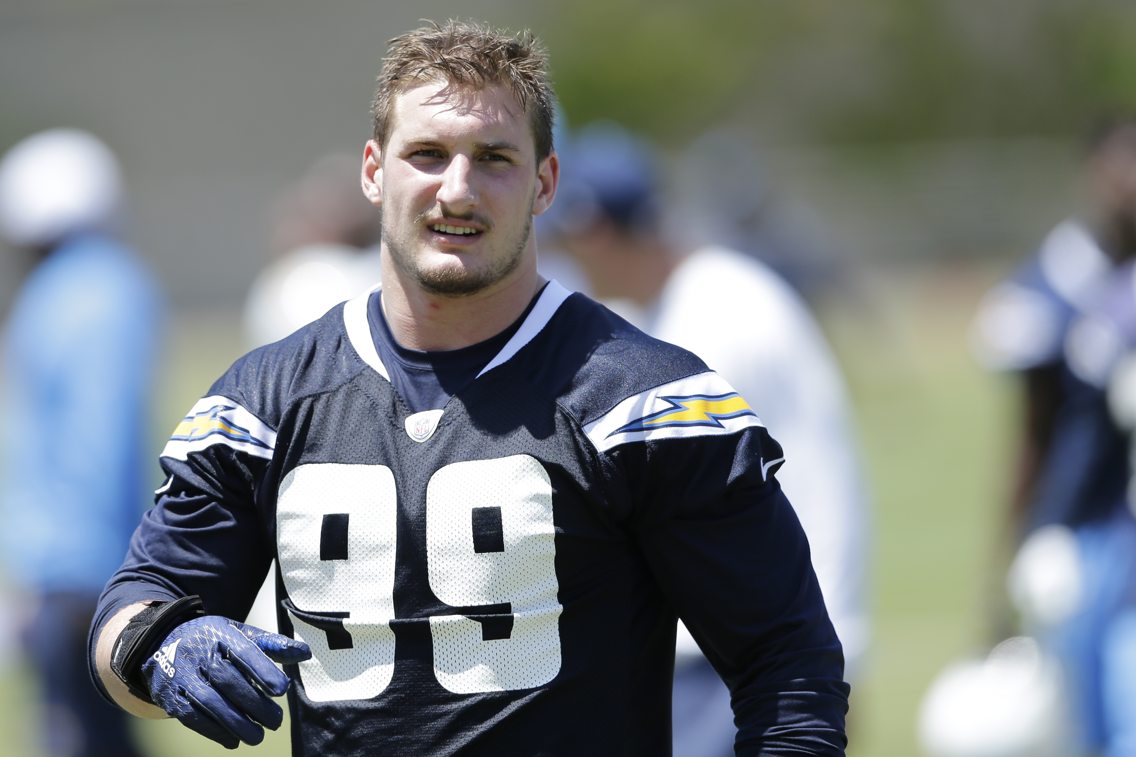 FILE - In this May 13, 2016, file photo, San Diego Chargers rookie defensive end Joey Bosa trains during an NFL football rookie training camp in San Diego. The Chargers have withdrawn their contract offer to first-round draft pick Joey Bosa and will restr