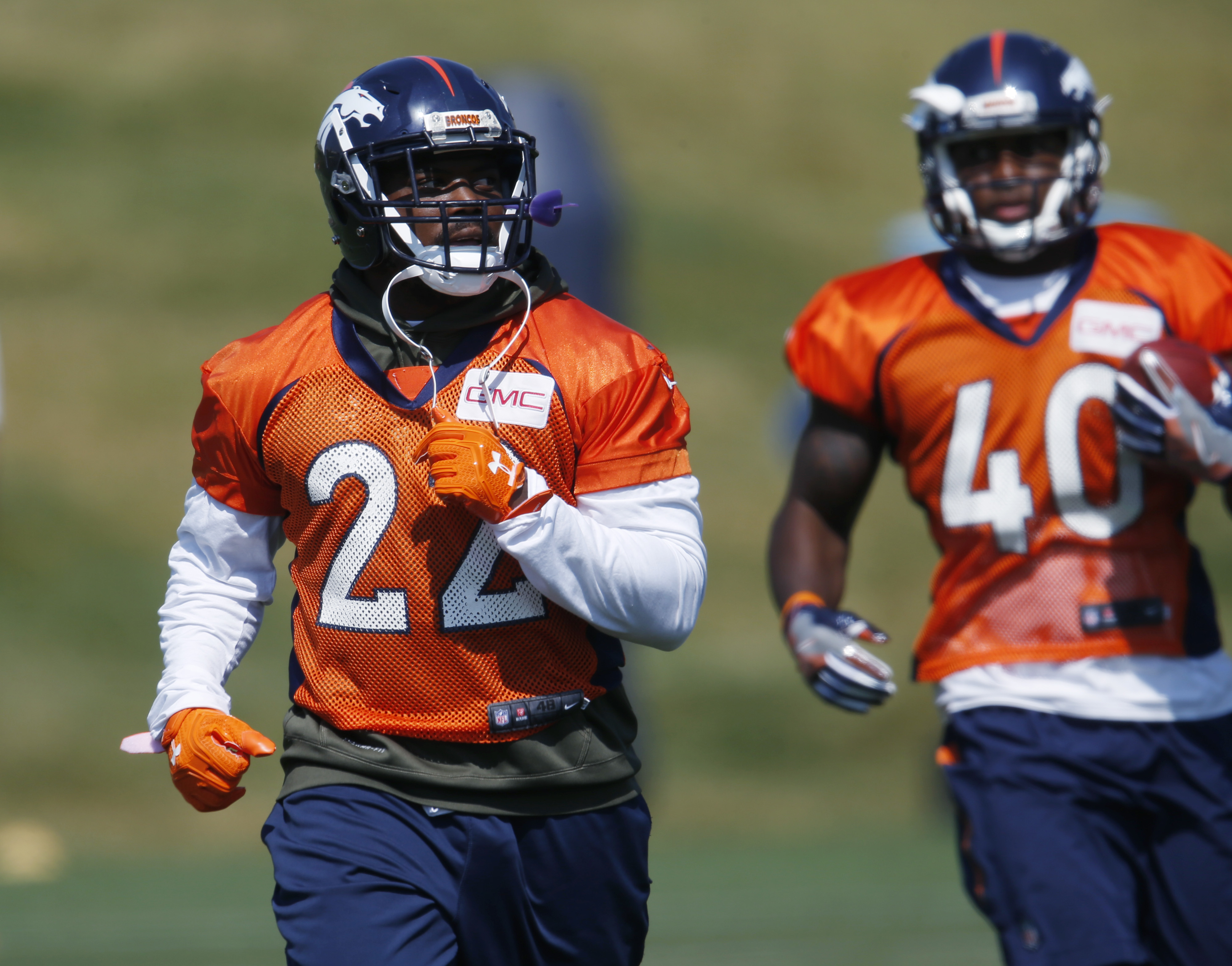 Denver Broncos running backs C.J. Anderson, front, and Juwan Thompson take part in drills during the team's NFL football practice at the Broncos' headquarters on Thursday, Aug. 25, 2016, in Englewood, Colo. (AP Photo/David Zalubowski)